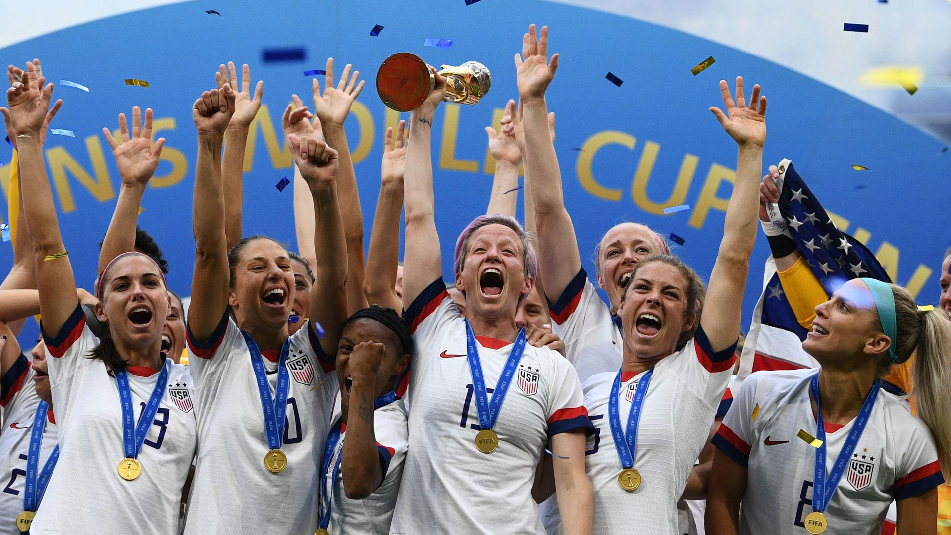 The U.S. players with their 4th World Cup in Lyon, central-eastern France.