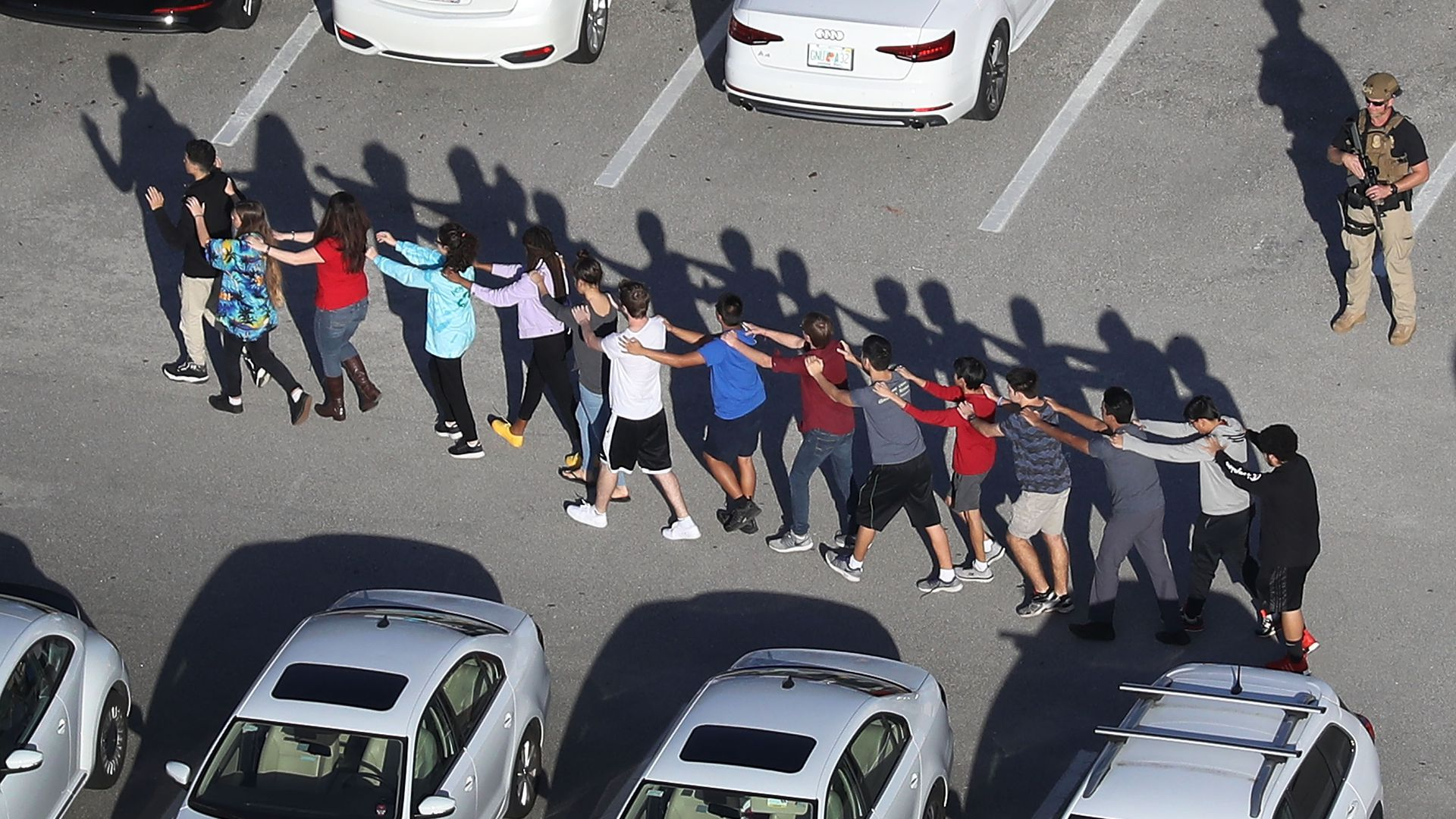 People being brought out of the Marjory Stoneman Douglas High School after a shooting at the school on February 14, 2018 in Parkland, Florida.
