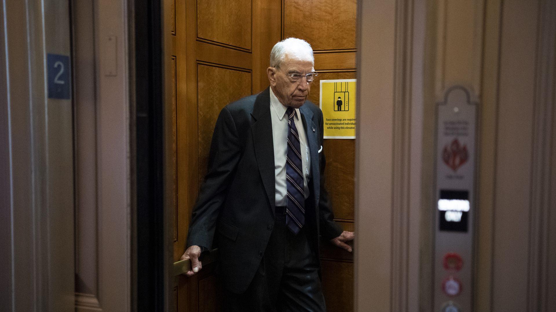 Sen. Chuck Grassley of Iowa stands in an elevator in Washington.