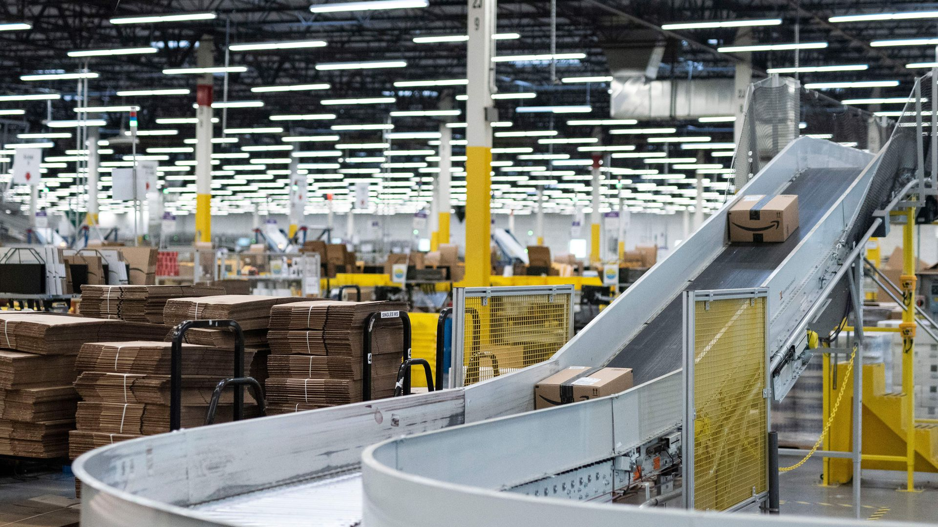 Package moves along conveyer belt in warehouse