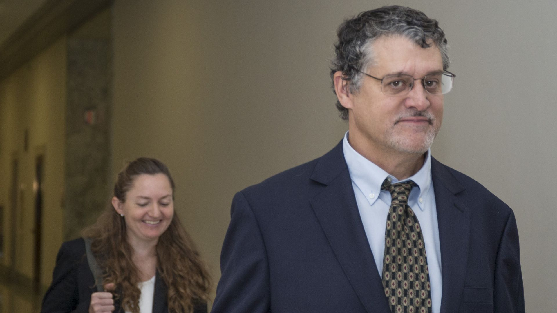Glenn Simpson looks at the camera as he walks into a hearing.