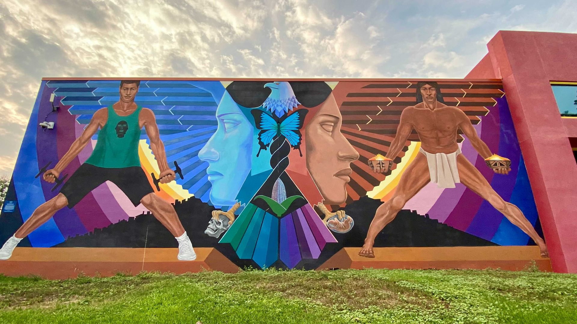 A photo of a large mural painted on a wall at the La Alma Recreation Center.