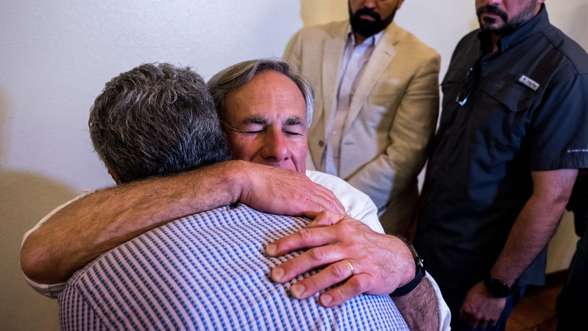 Texas governor hugging el paso resident