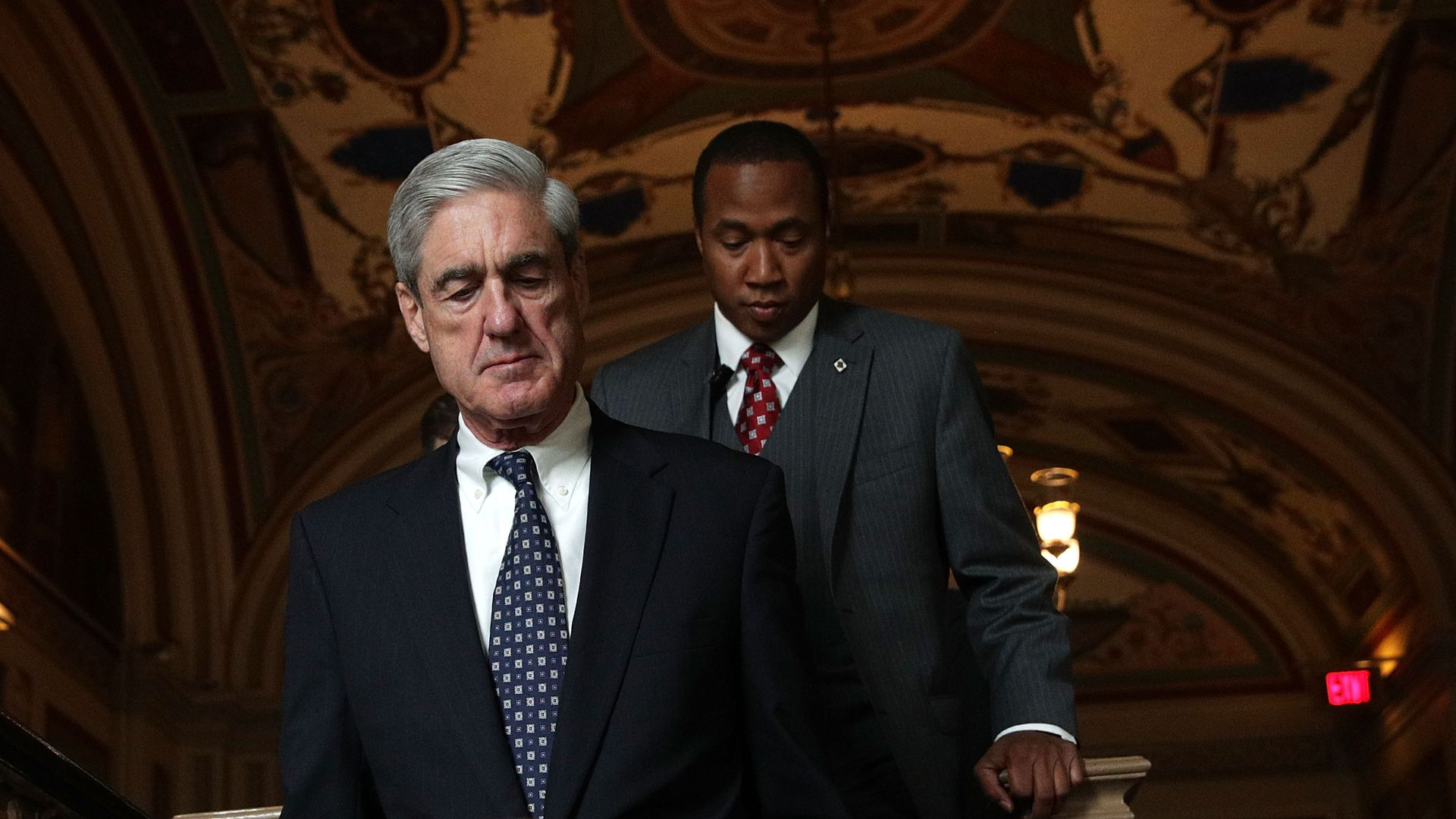 Robert Mueller walks down a flight of stairs in the Capitol