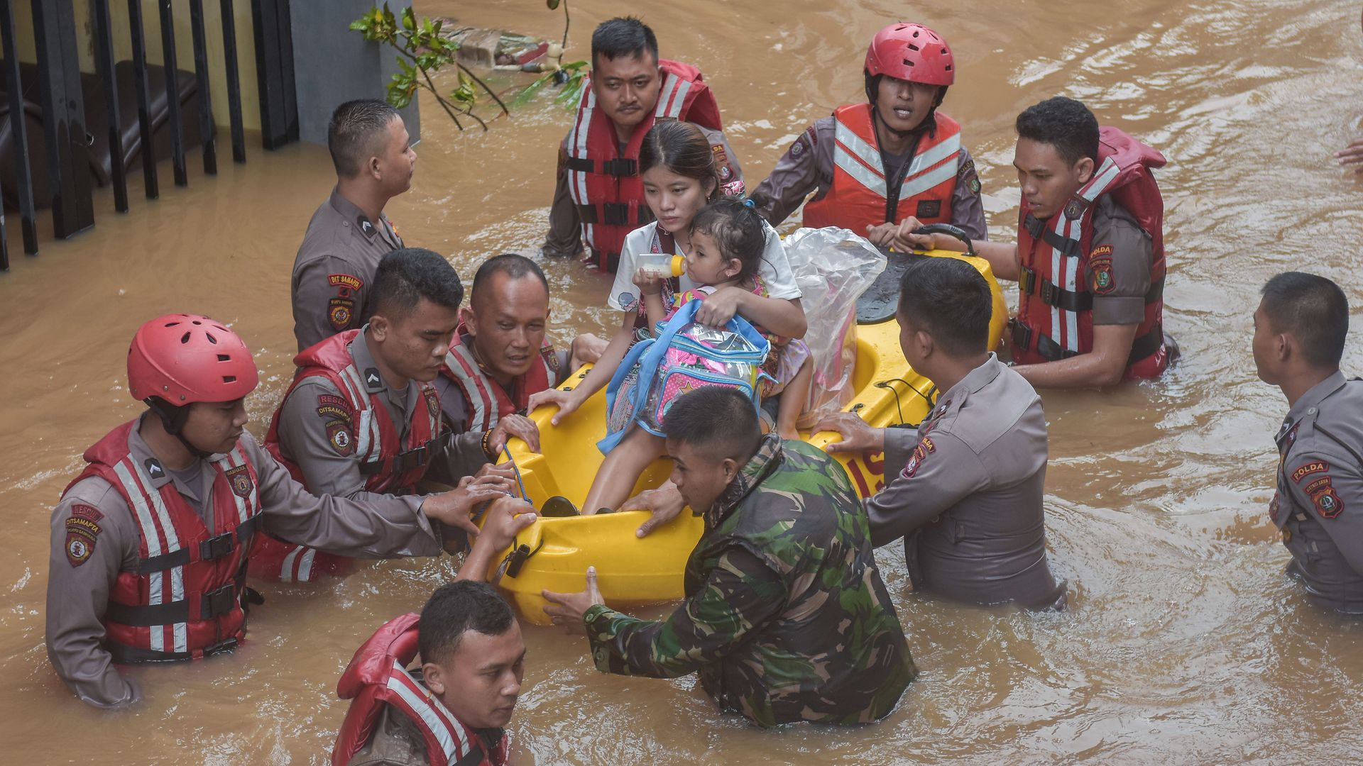 A rescue team evacuates residents from their flooded houses in Jakarta.