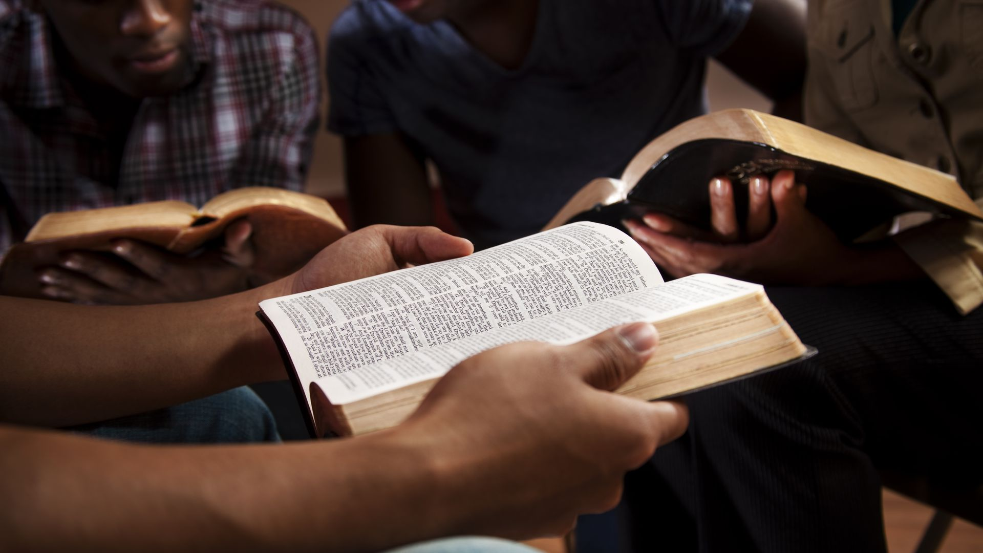 Group of people reading the Bible