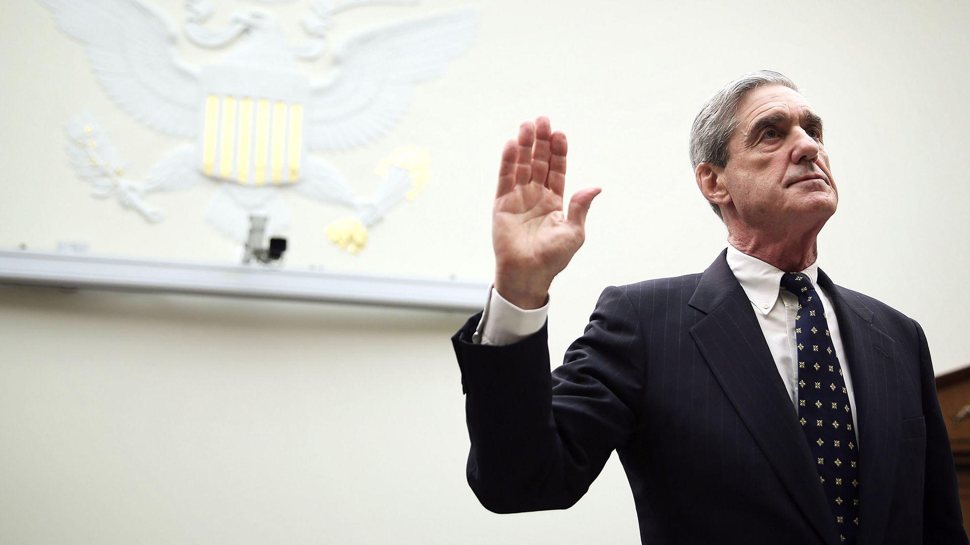 Bob Mueller raises hand.