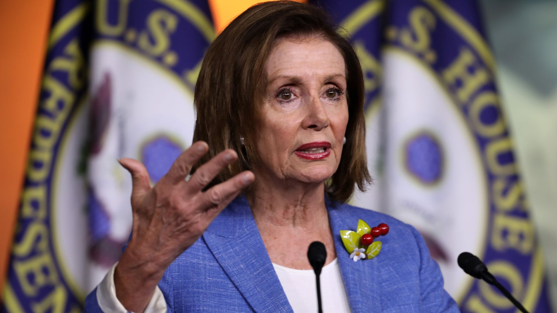 Nancy Pelosi gesturing with her hand.