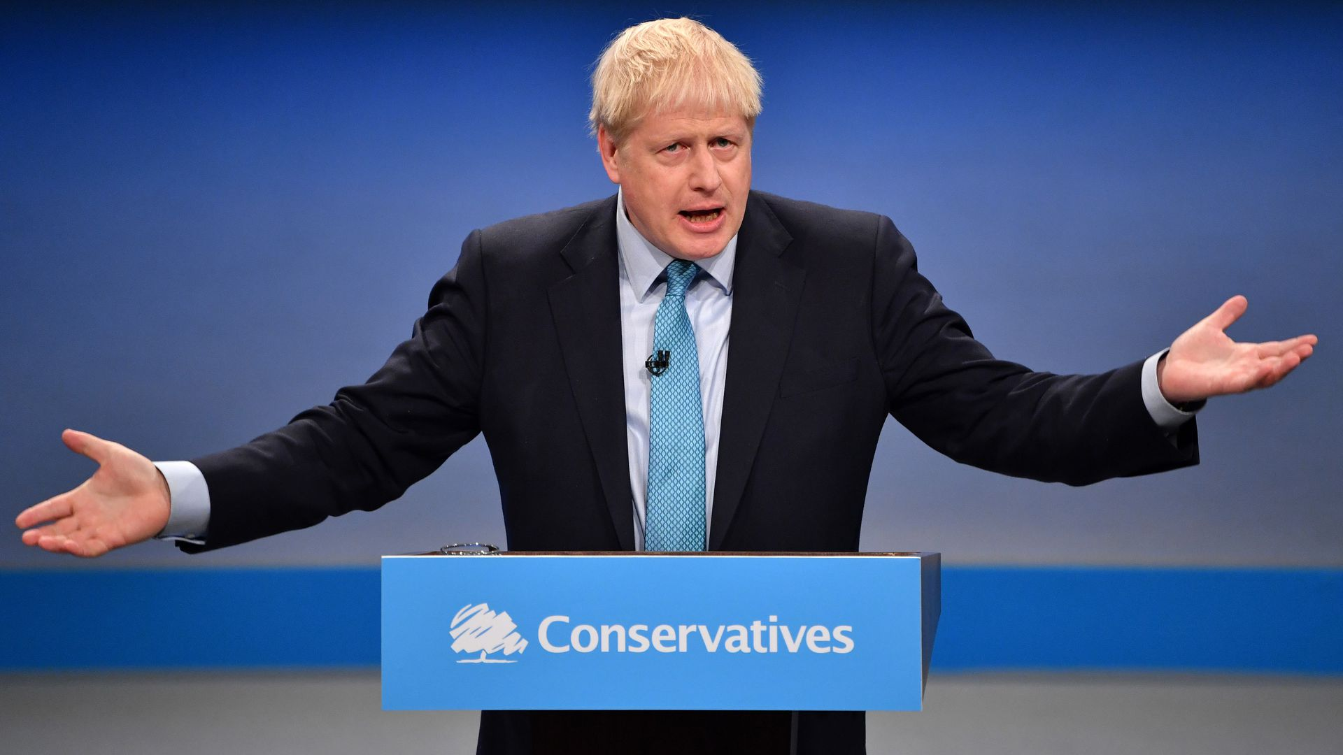 Britain's Prime Minister Boris Johnson delivers his keynote speechat the annual Conservative Party conference in Manchester, north-west England on October 2