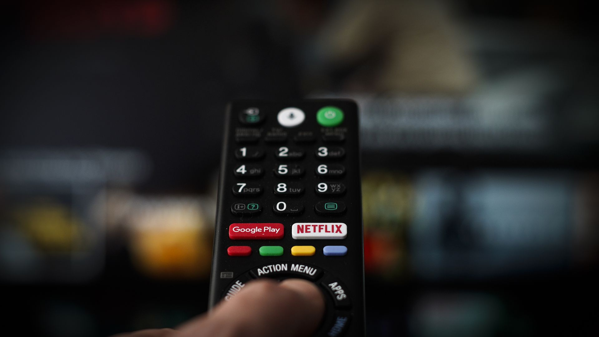 A button for launching the Netflix application is seen on a remote control in this photo illustration.