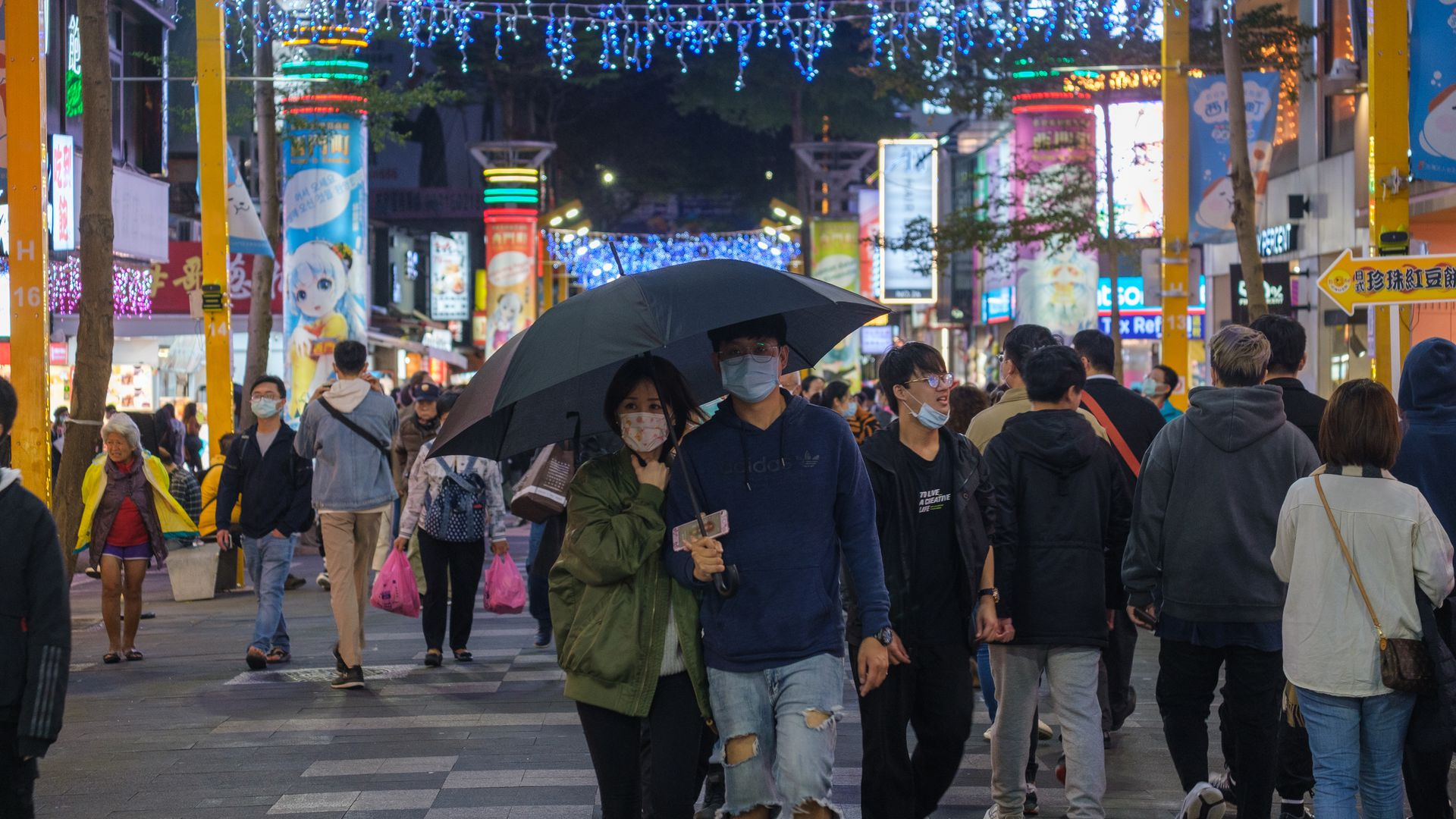eople wearing face masks shop in Ximen, Taipei, Taiwan on December 05