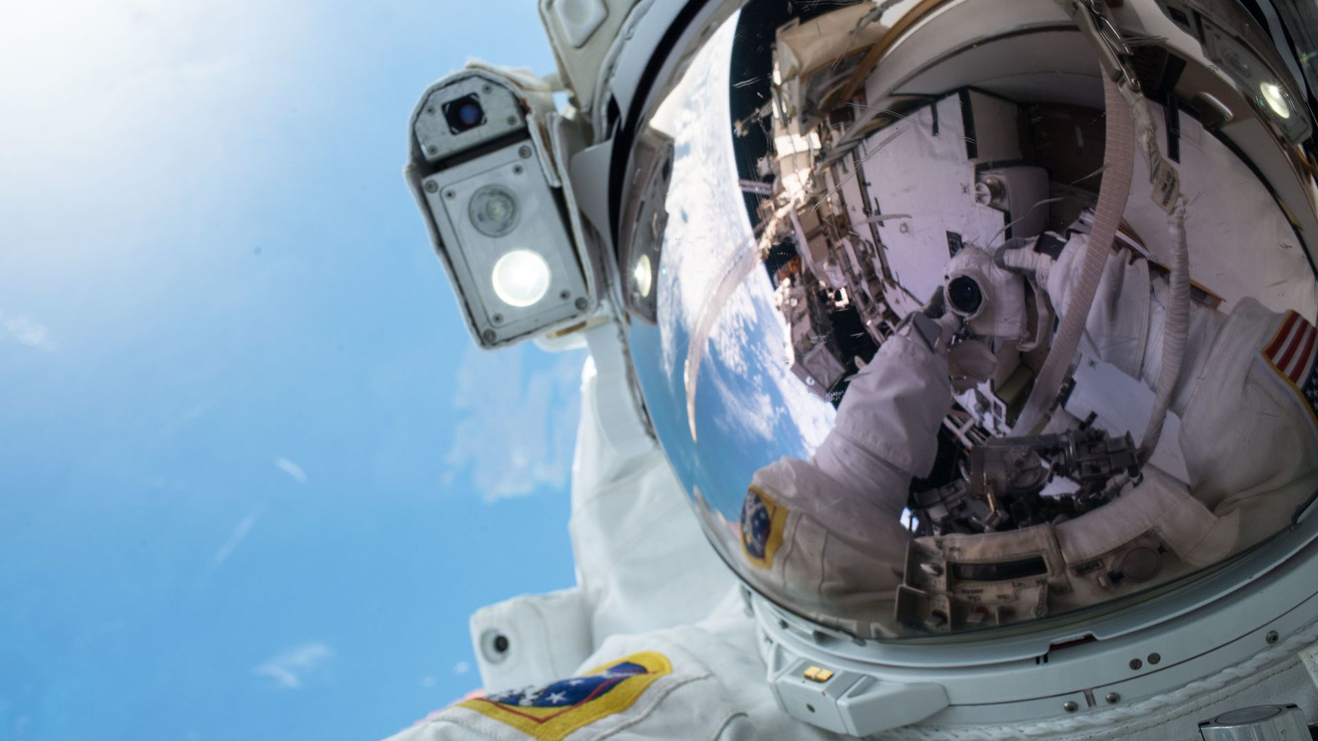 An astronaut selfie in space with Earth in the background
