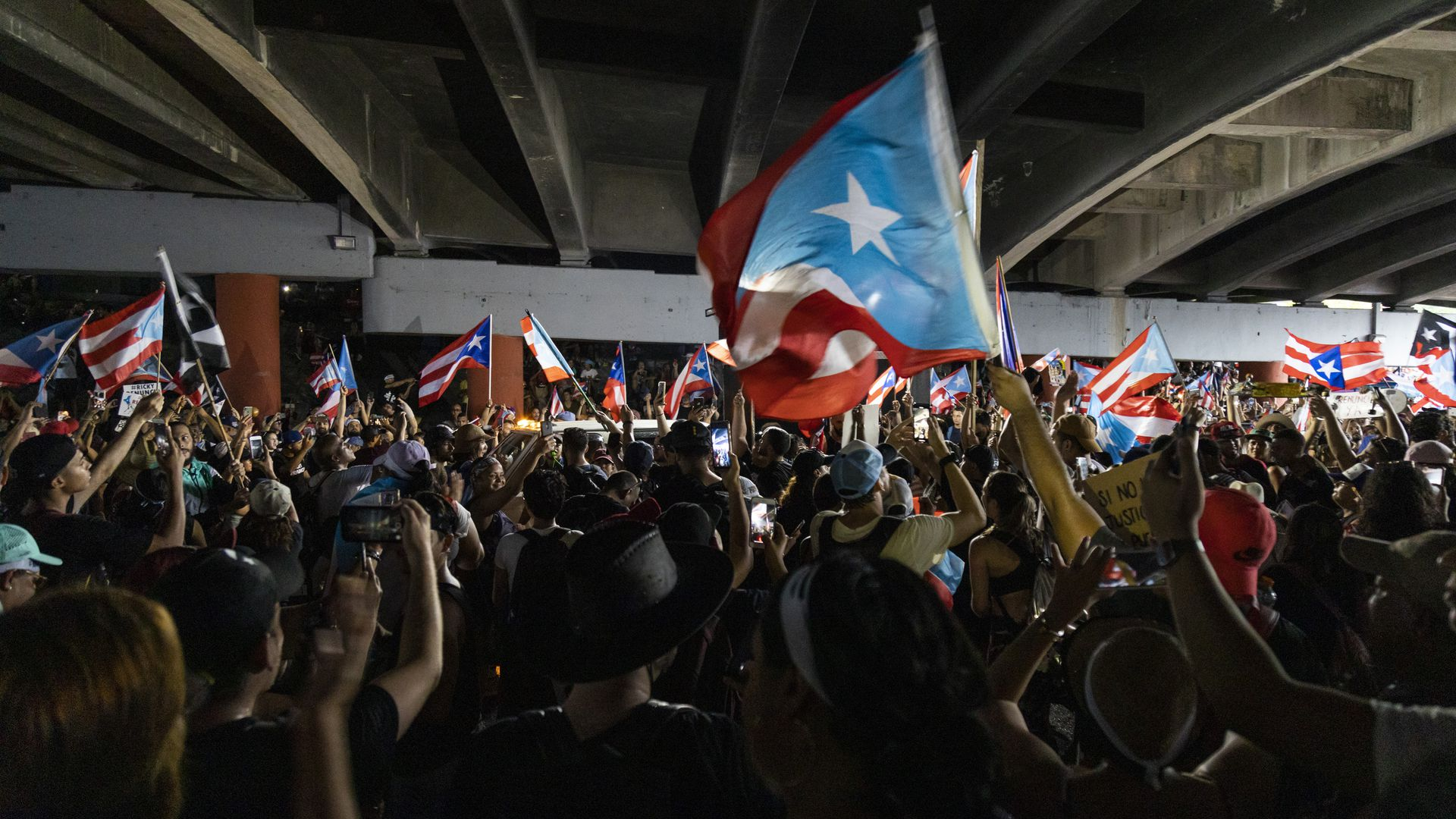 Puerto Rico police target crowds with tear gas in bid to break up massive street protests