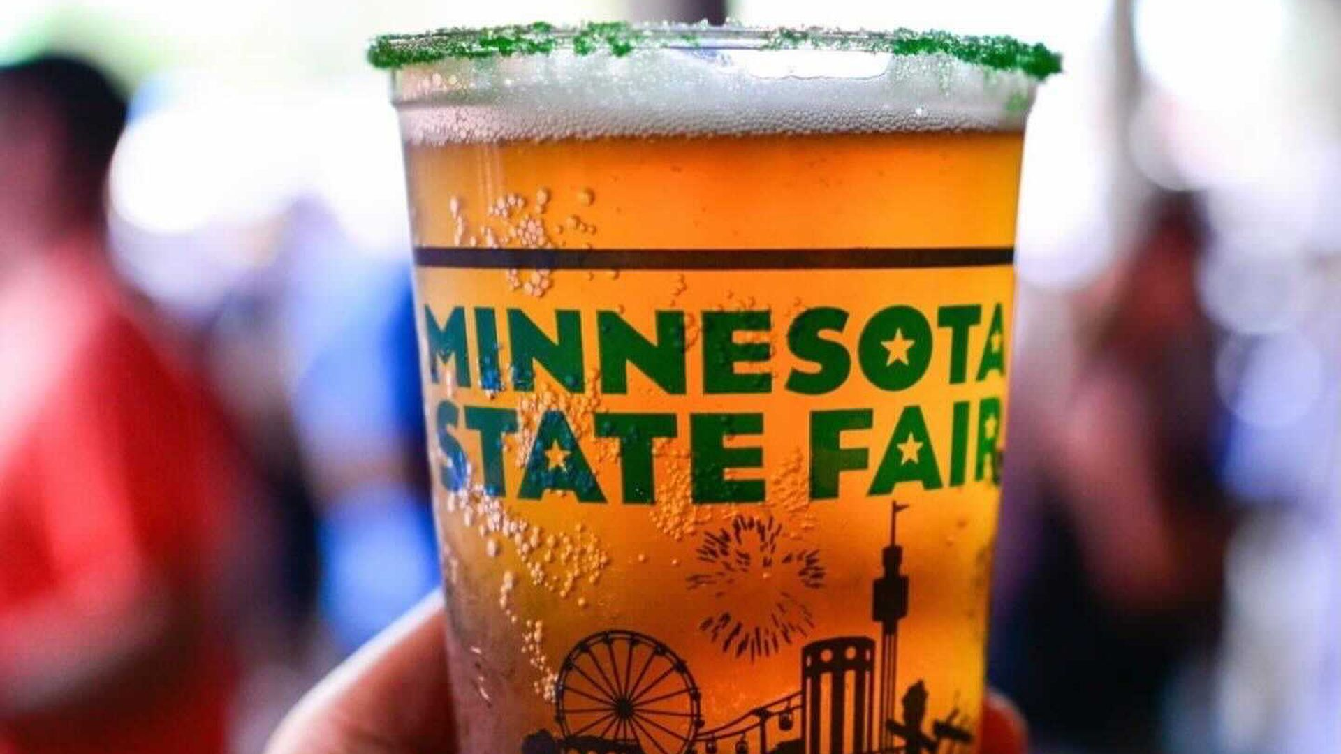 A photo of a full beer in a plastic cup that says Minnesota State Fair.