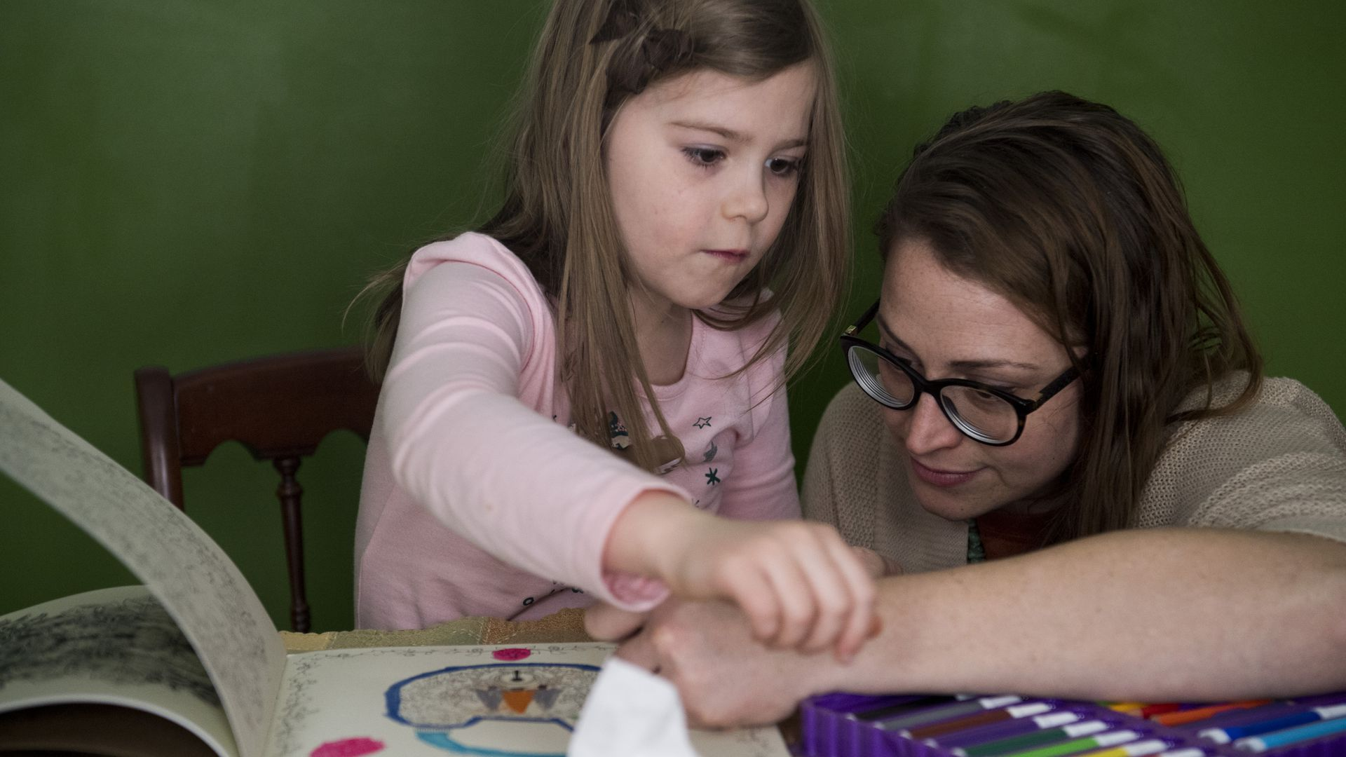 A mother on Medicaid in Kentucky plays with her daughter