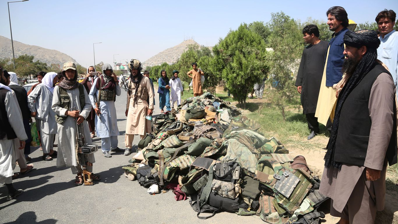 Taliban fighters stand beside the belongings of Afghan security soldiers in Kabul on Monday. Photo: Str/Xinhua via Getty Images The Taliban accumulate
