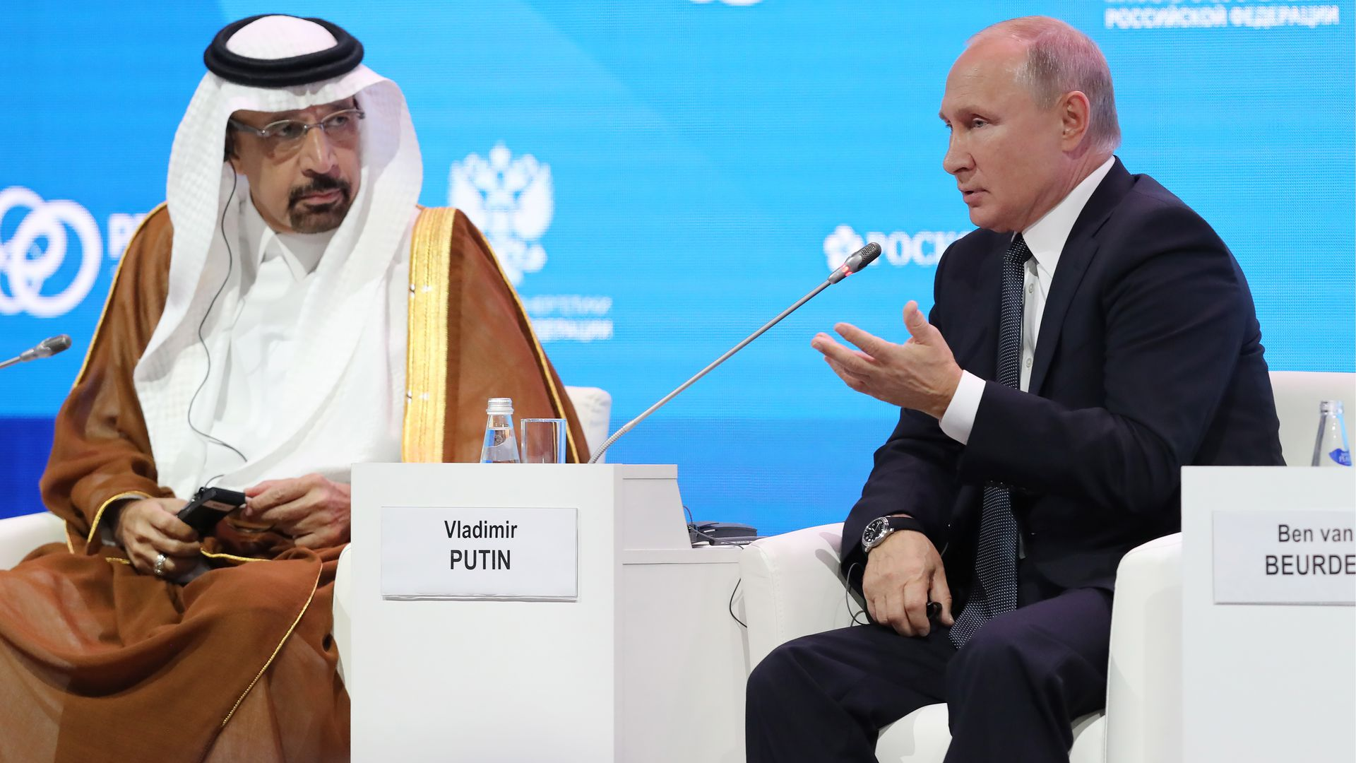 Khalid A. Al-Falih and Vladimir Putin seated onstage at a conference