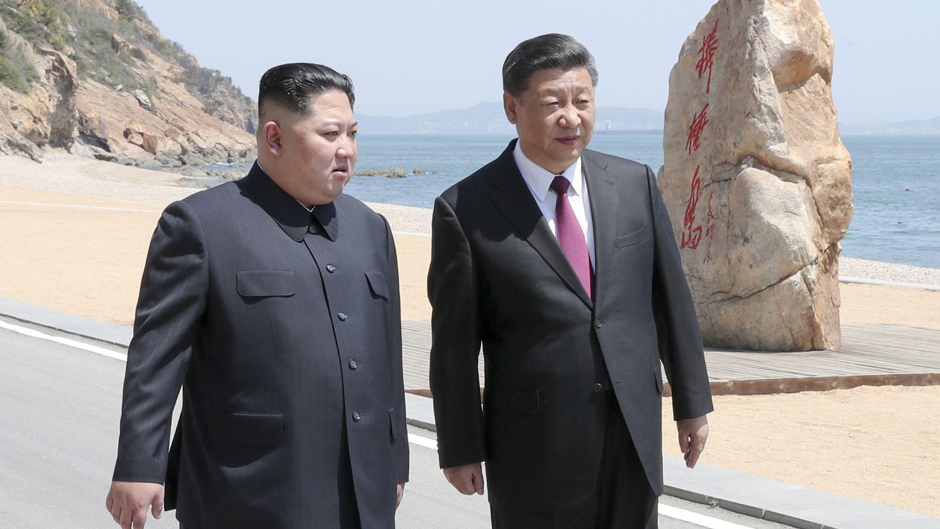 Kim Jong-un and Xi Jingping stroll in China