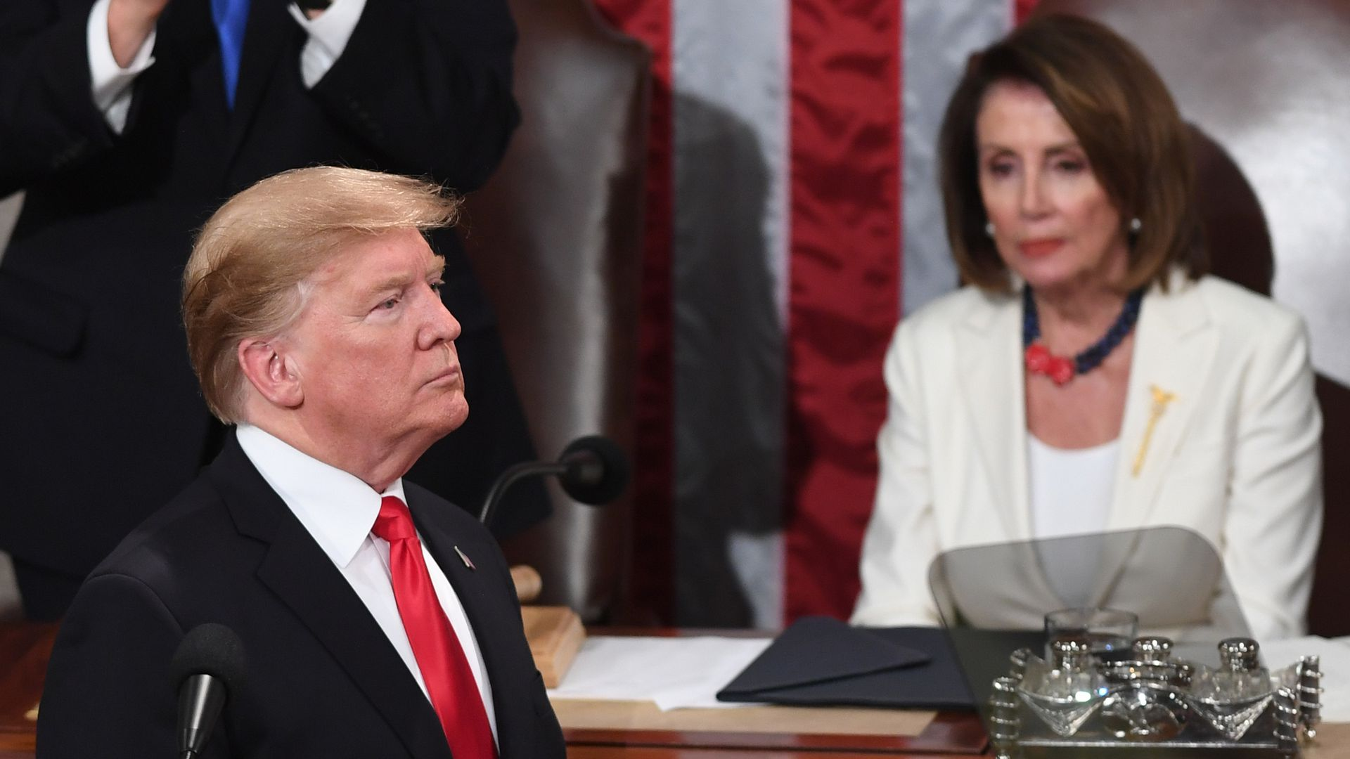 President Trump, flanked by Speaker of the US House of Representatives Nancy Pelosi, delivers the State of the Union address at the US Capitol in Washington, DC, on February 5, 2019.