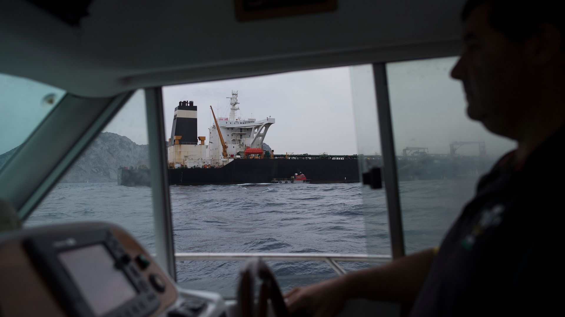 This image shows a boat through another boat's window