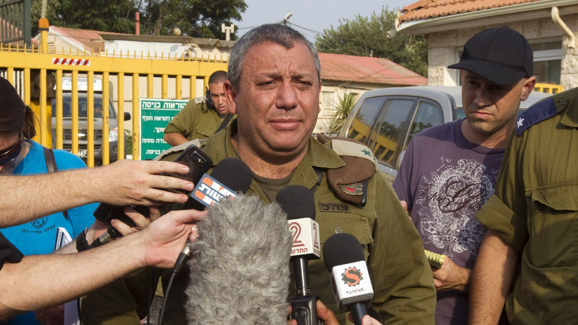 Israeli Defense chief talks while surrounded by reporters