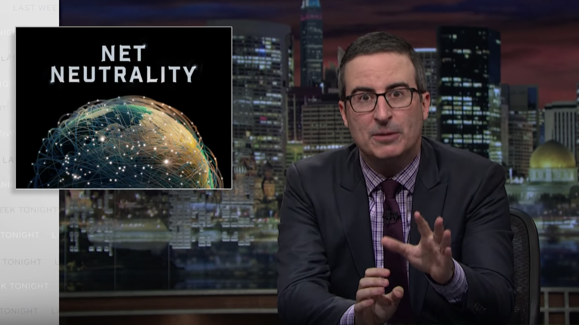 "John Oliver on screen with the words ""Net Neutrality"""