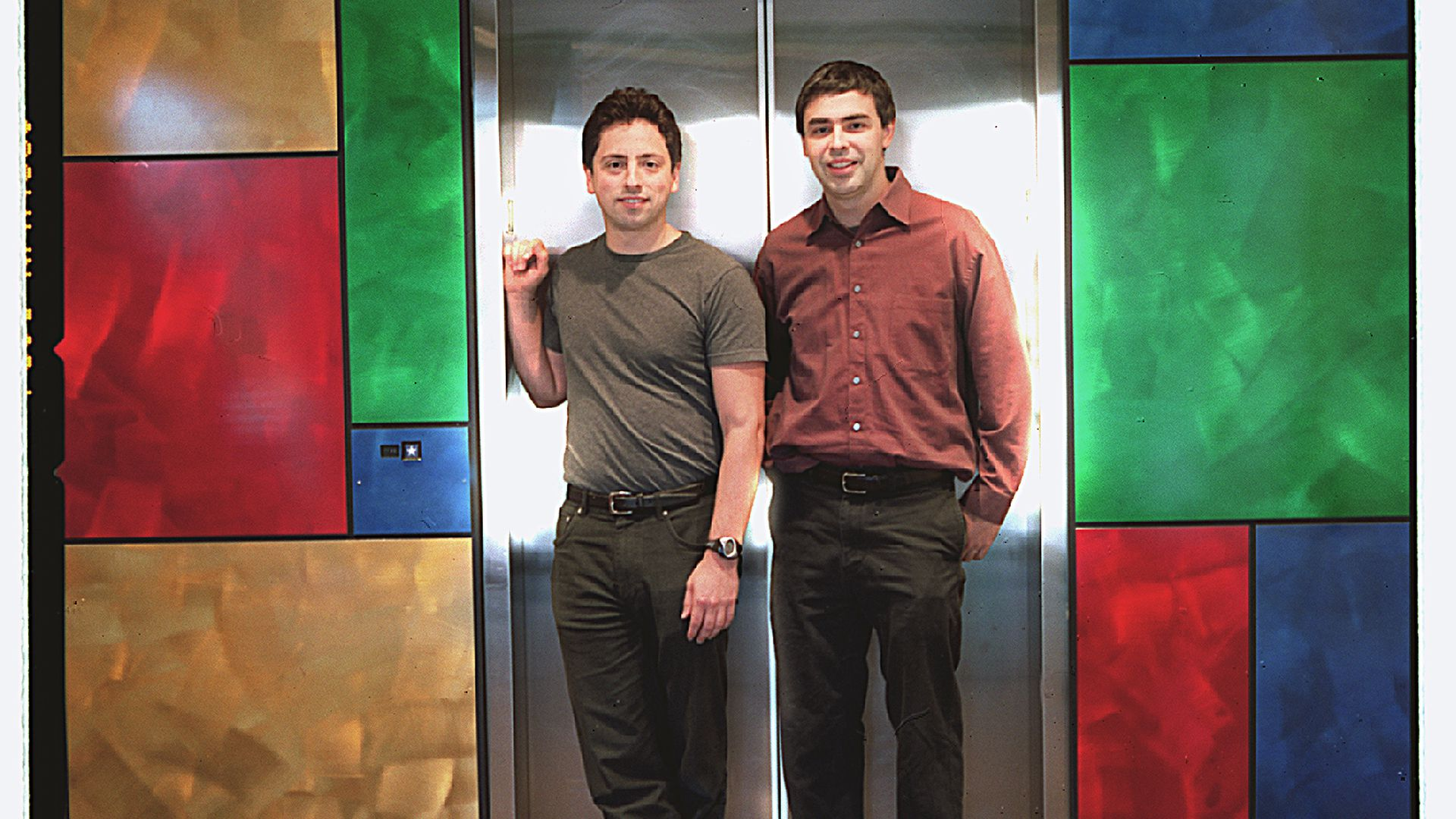Photo of Google founders Sergey Brin and Larry Page in 2002 leaving an elevator at Google's office