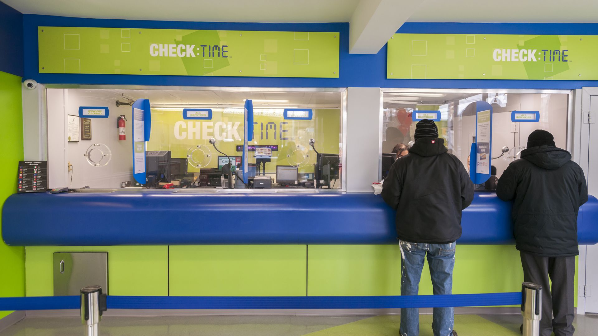 Customers in the newly remodeled branch of Check:Time in the Williamsburg neighborhood of Brooklyn in New York on Thursday, January 14, 2016.