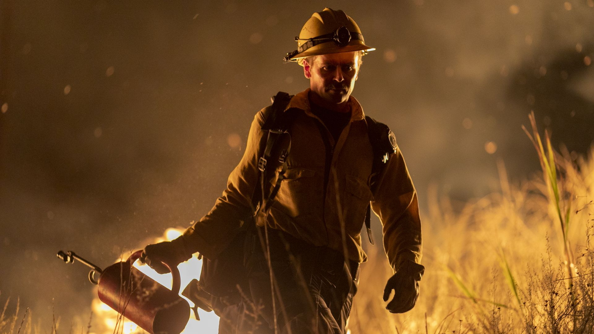 A firefighter using a drip torch near Somis, California