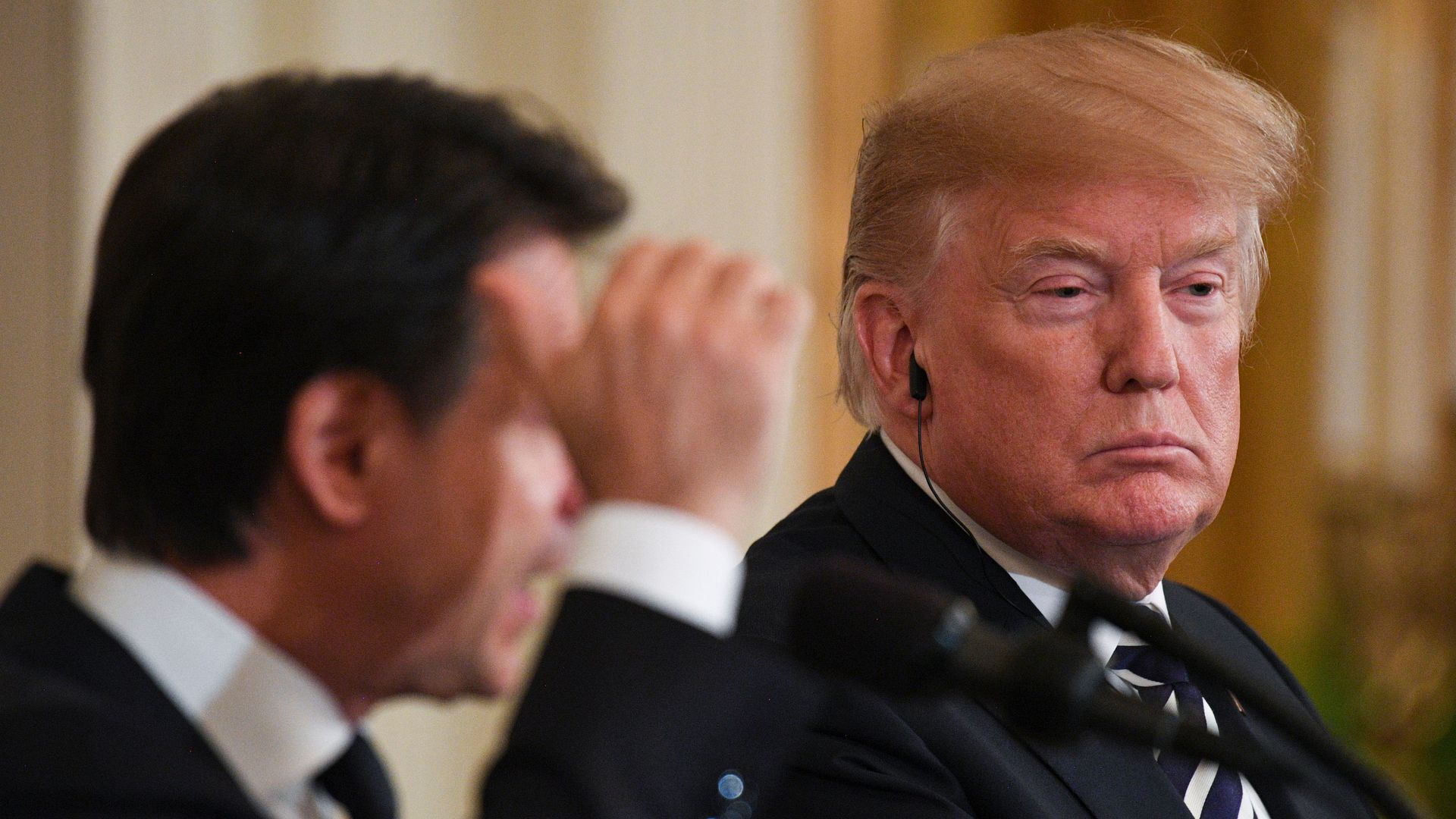 President Trump listens during a joint press conference with Italian Prime Minister Giuseppe Conte in the East Room of the White House in Washington, DC, July 30, 2018.
