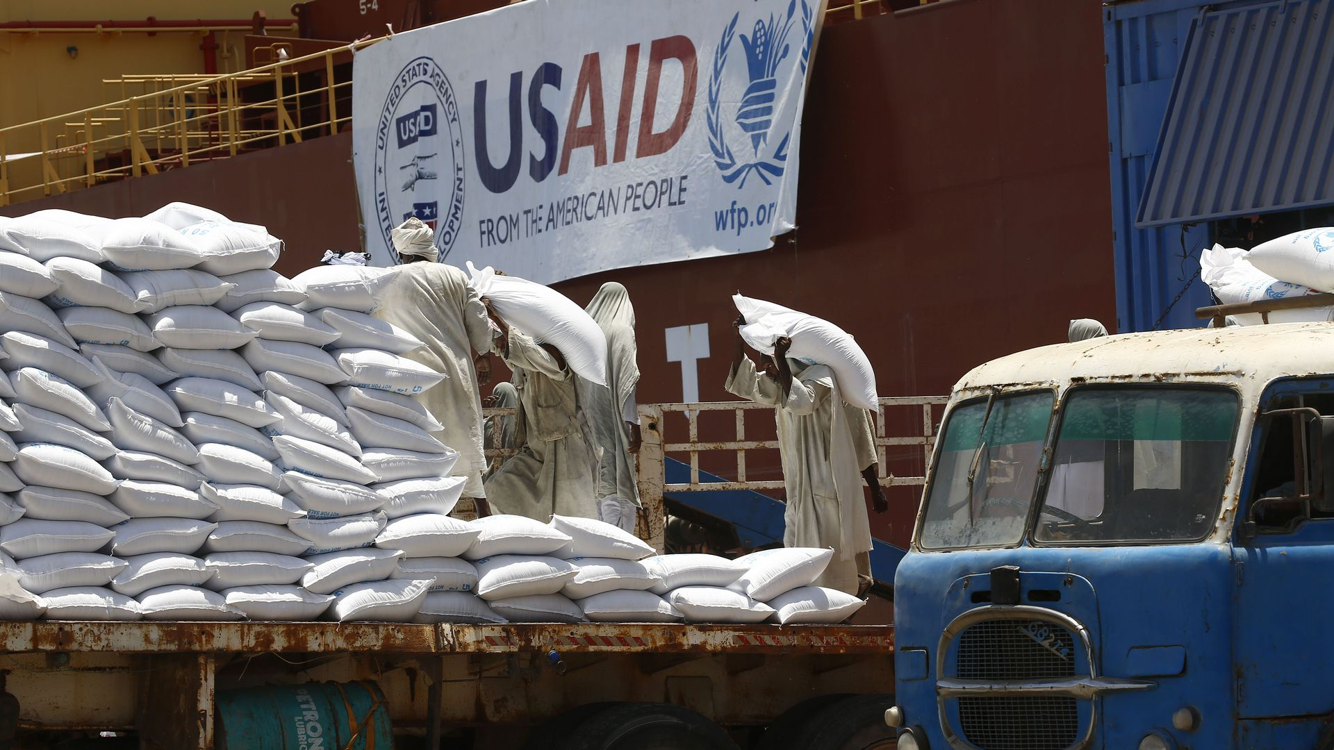 Bags of grain from USAID on a truck bed