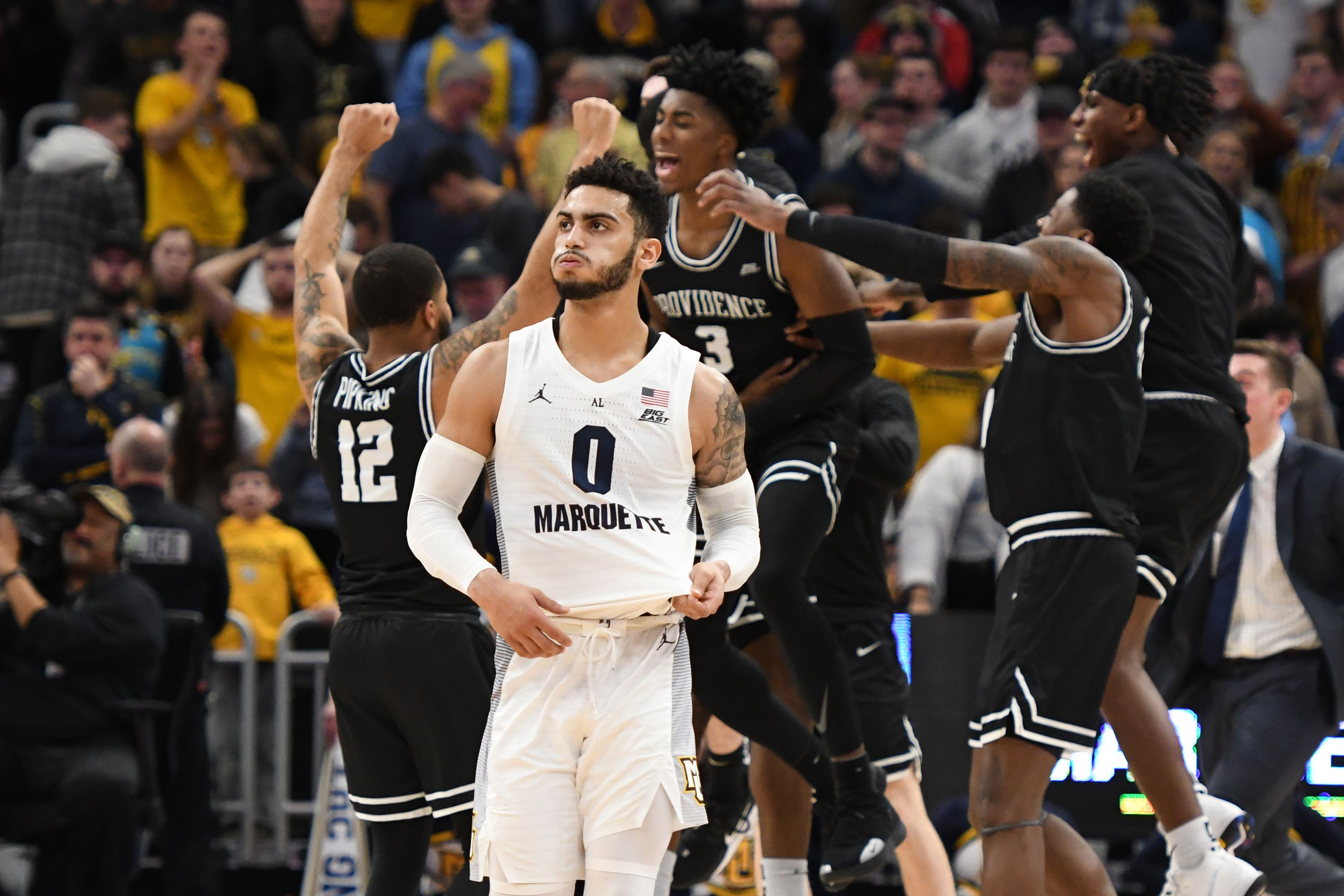 Providence players celebrating behind Markus Howard