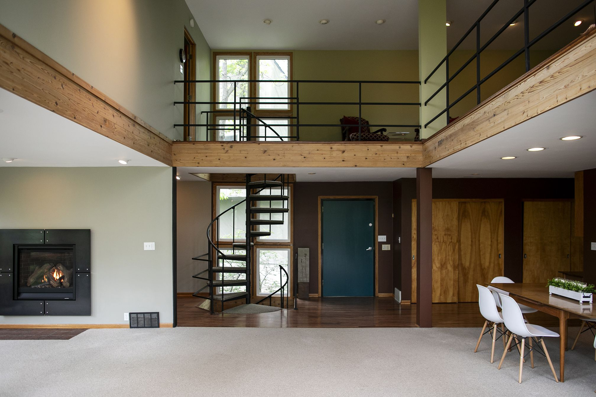 The interior of a home of a home for sale in Waukee, Iowa, with a spiral staircase.