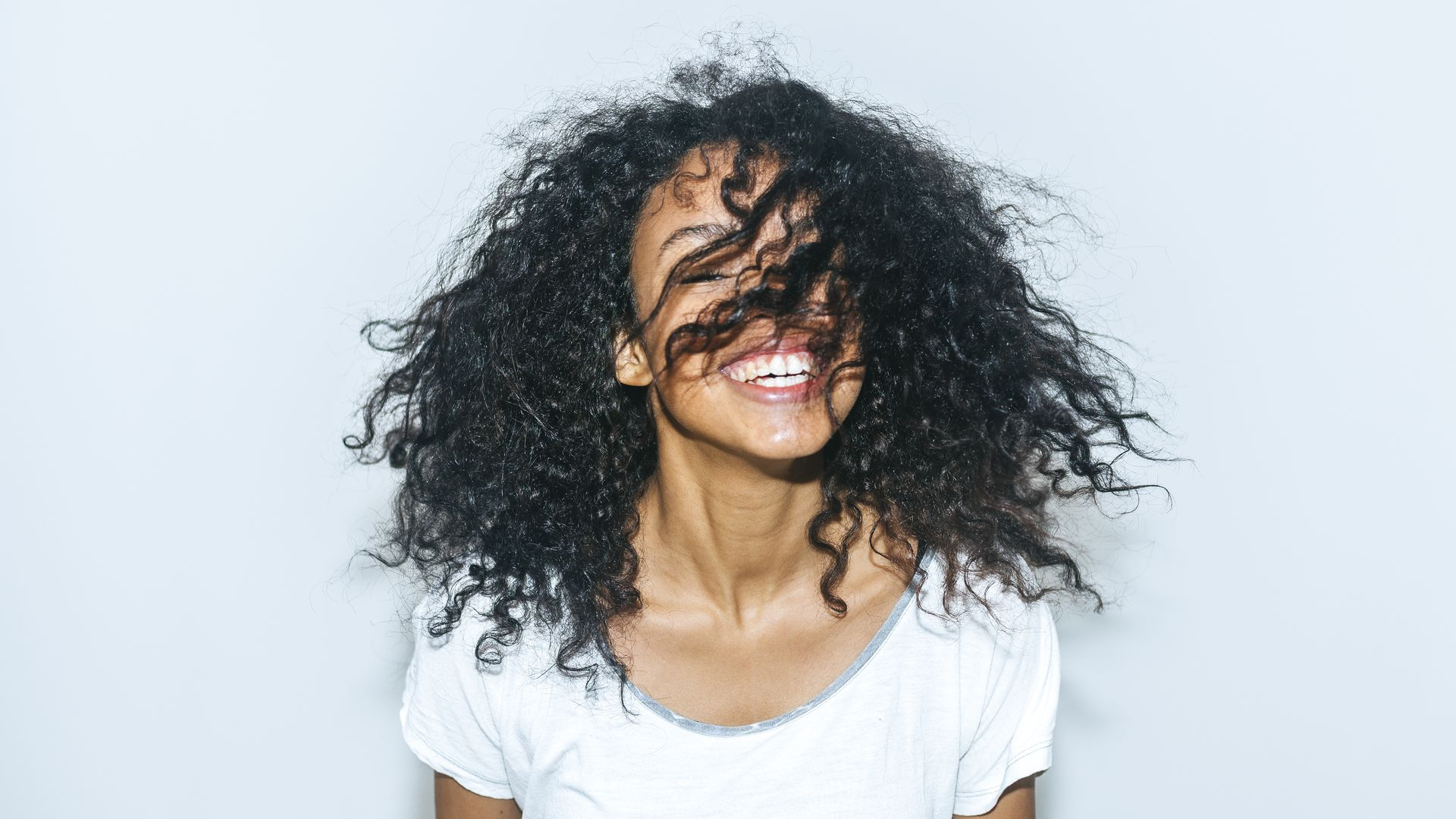 A woman smiling with her hair