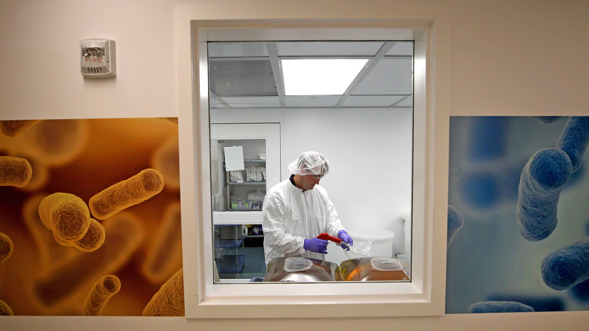 A technician in a pharmaceutical manufacturing facility