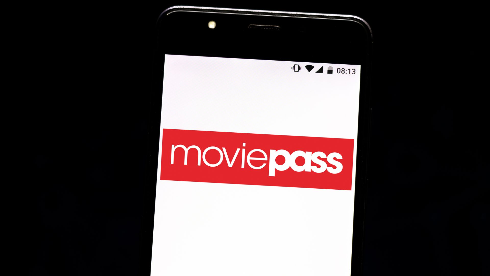 This image shows a phone with the Moviepass logo on it.