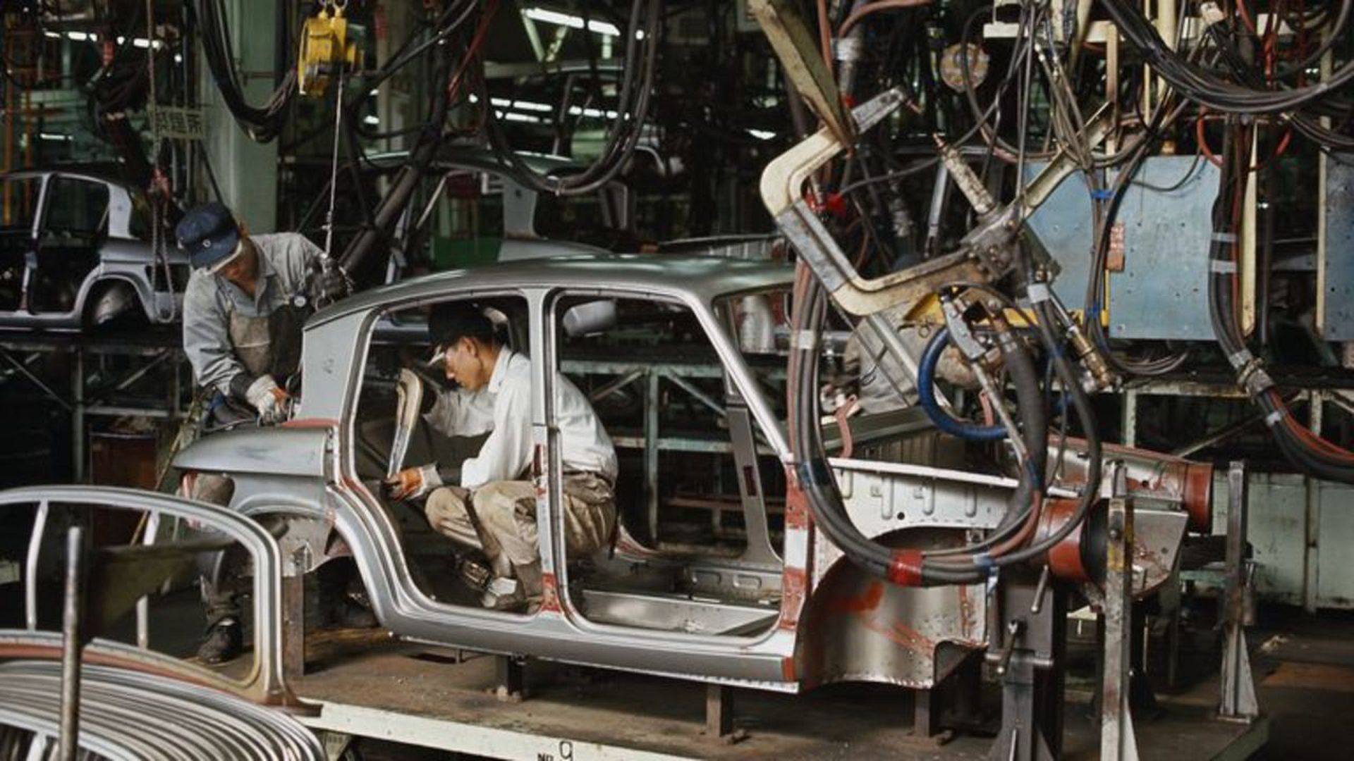Factory workers assembling a car. Photo: Jerry Cooke/Corbis via Getty Images