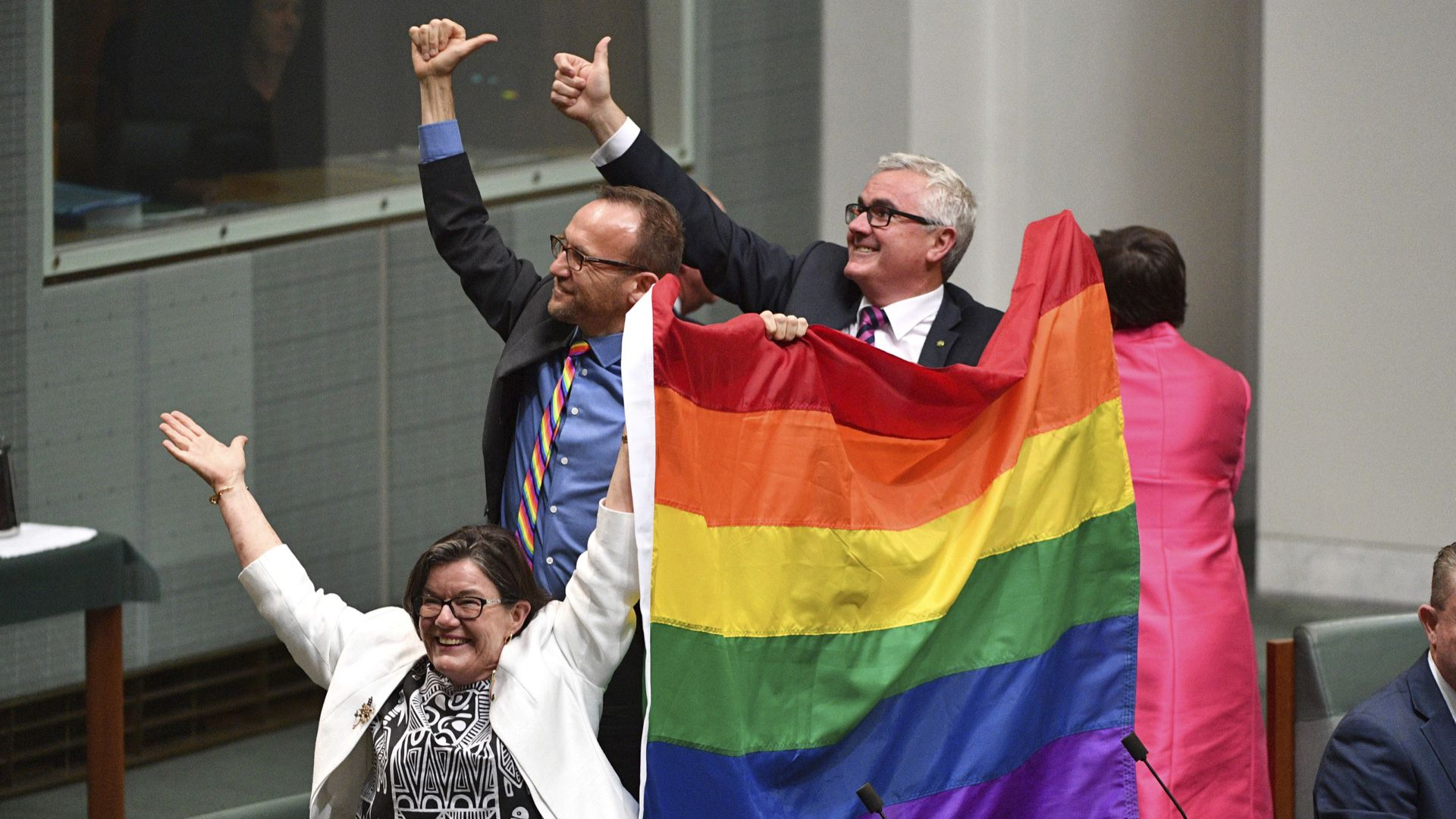 Australian MPs celebrate the same-sex marriage vote