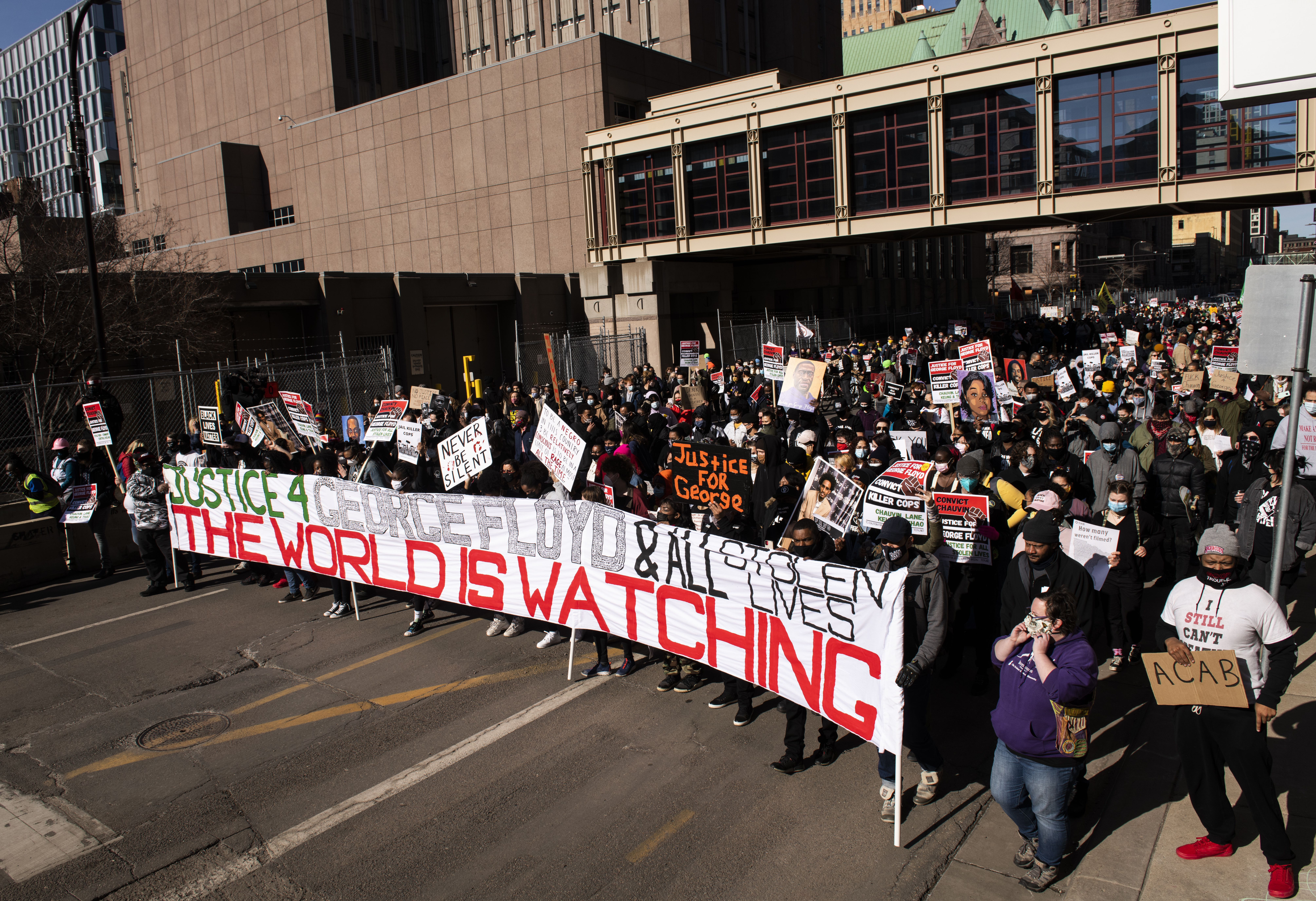 Demonstrators march in support of George Floyd