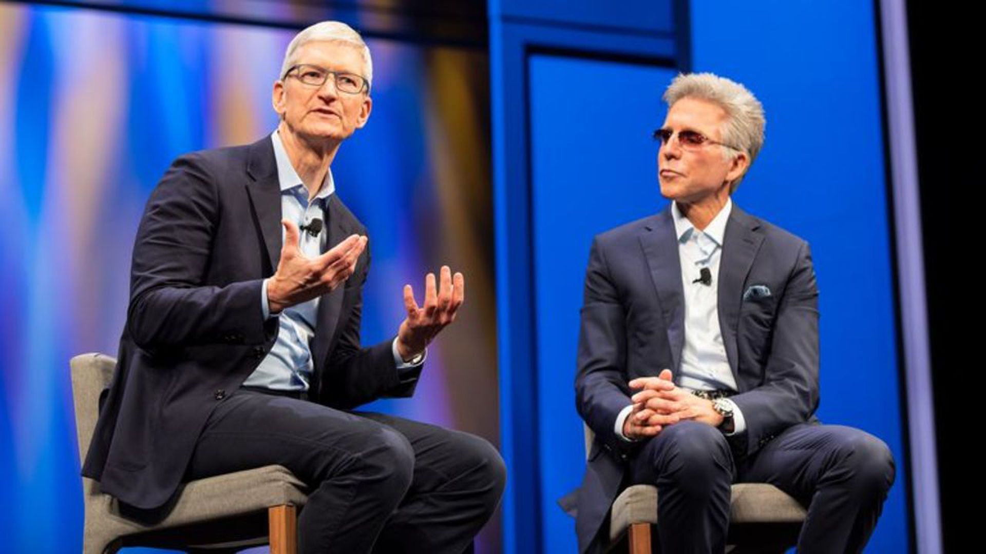 Tim Cook joined SAP CEO Bill McDermott (r) at its Sapphire conference to announce an expanded partnership. Photo: Apple