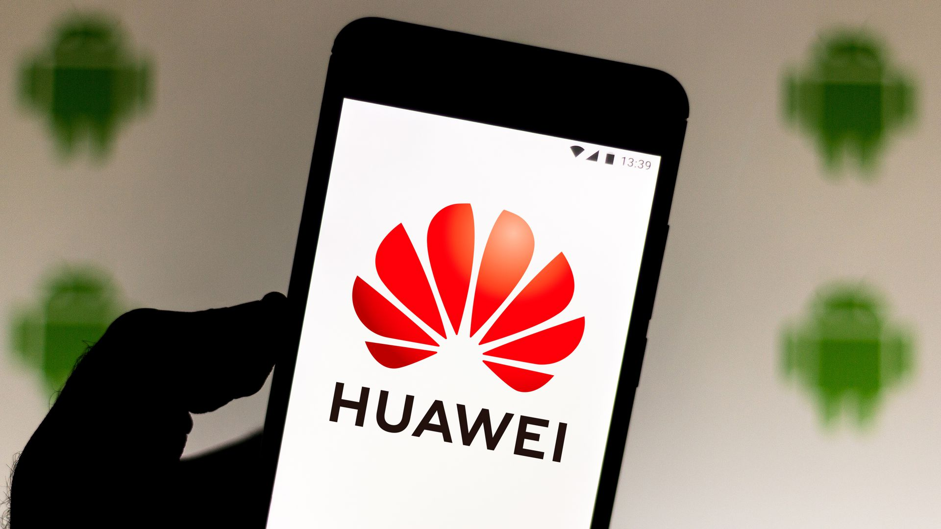 The Huawei logo on a phone.