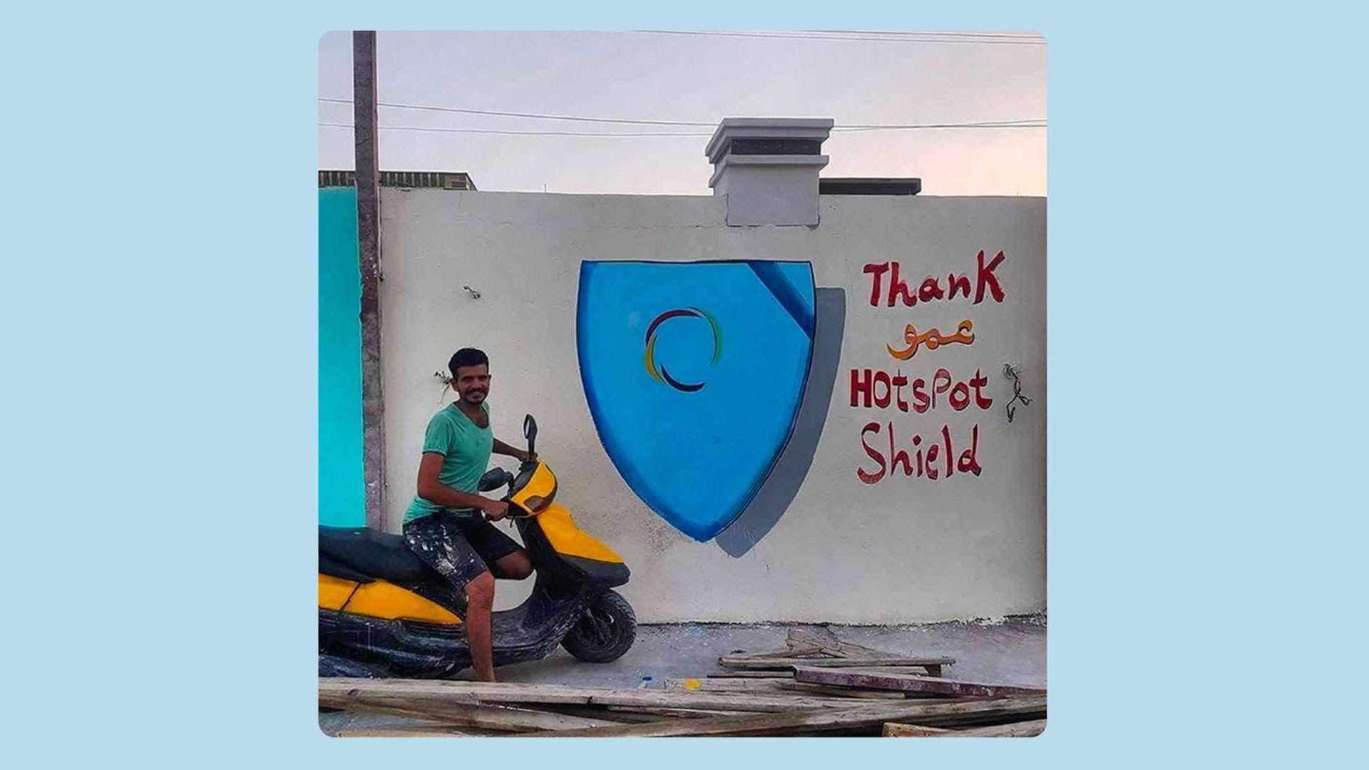Man on motorbike next to graffiti saying Thank you HotspotShield