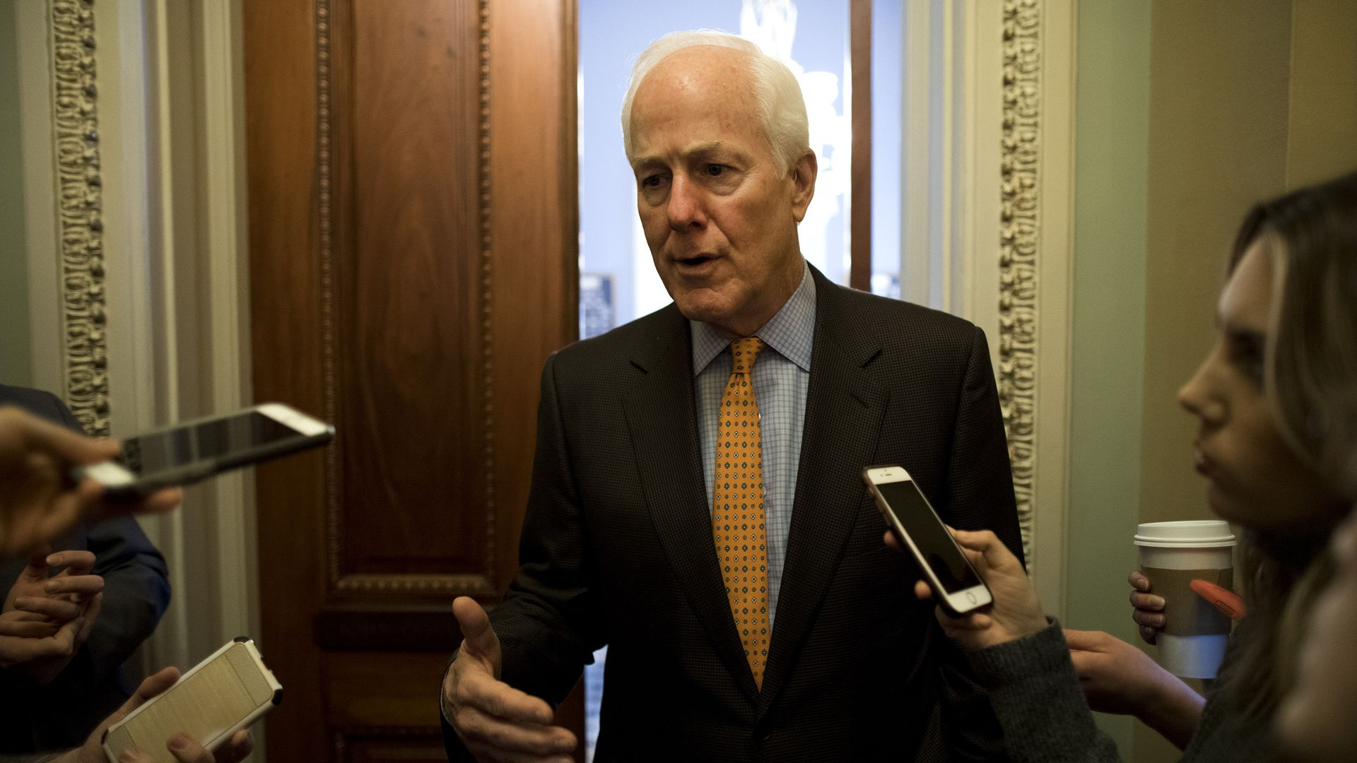John Cornyn talks to reporters