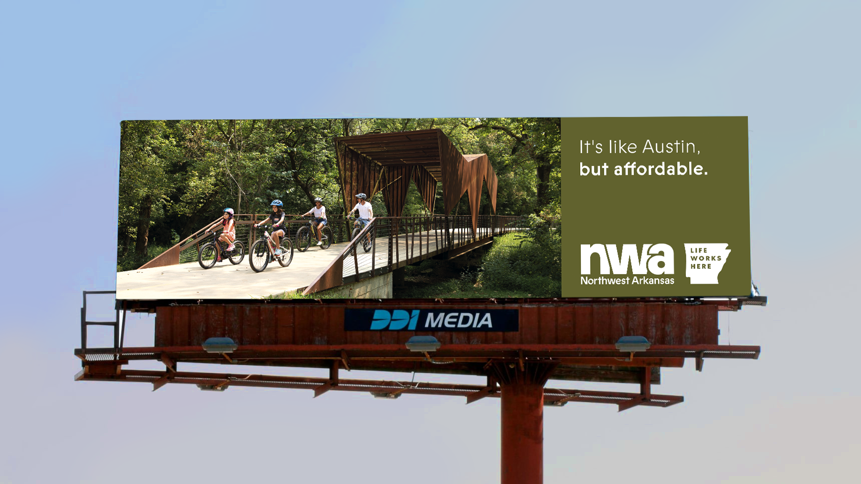 A billboard that reads It's like Austin, but affordable.