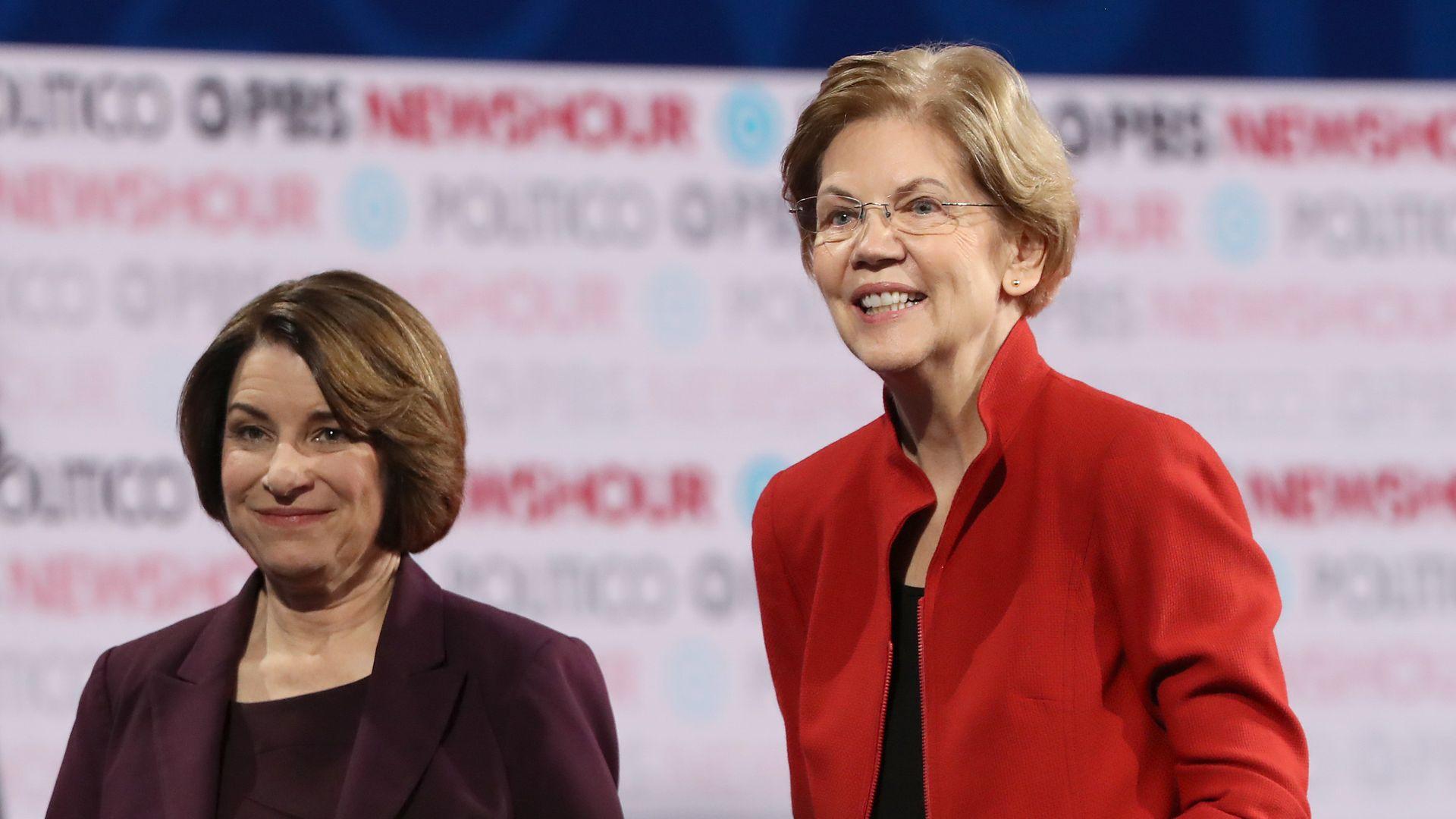 Democratic presidential candidate Sen. Elizabeth Warren (D-MA) (R) and Sen. Amy Klobuchar at a debate