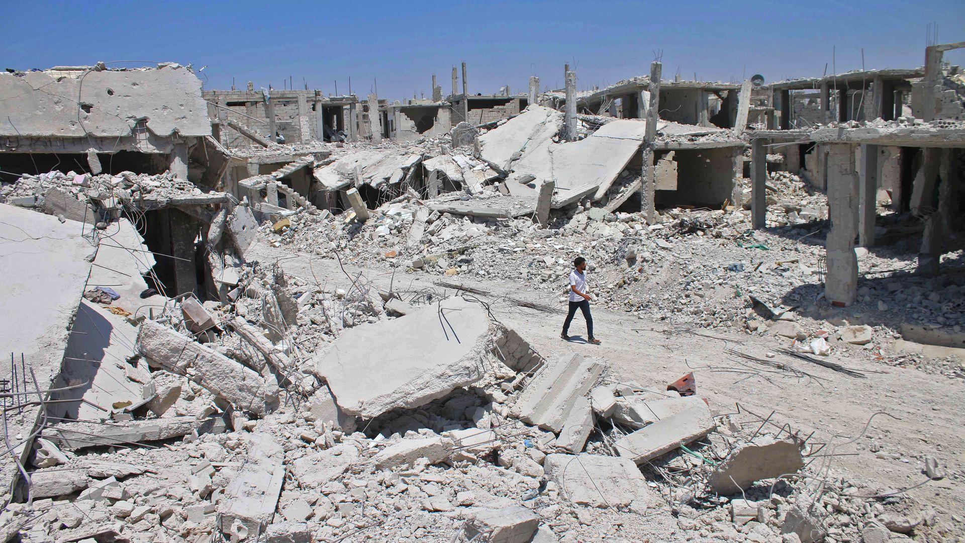A Syrian man walks down the street in rebel-held Daraa