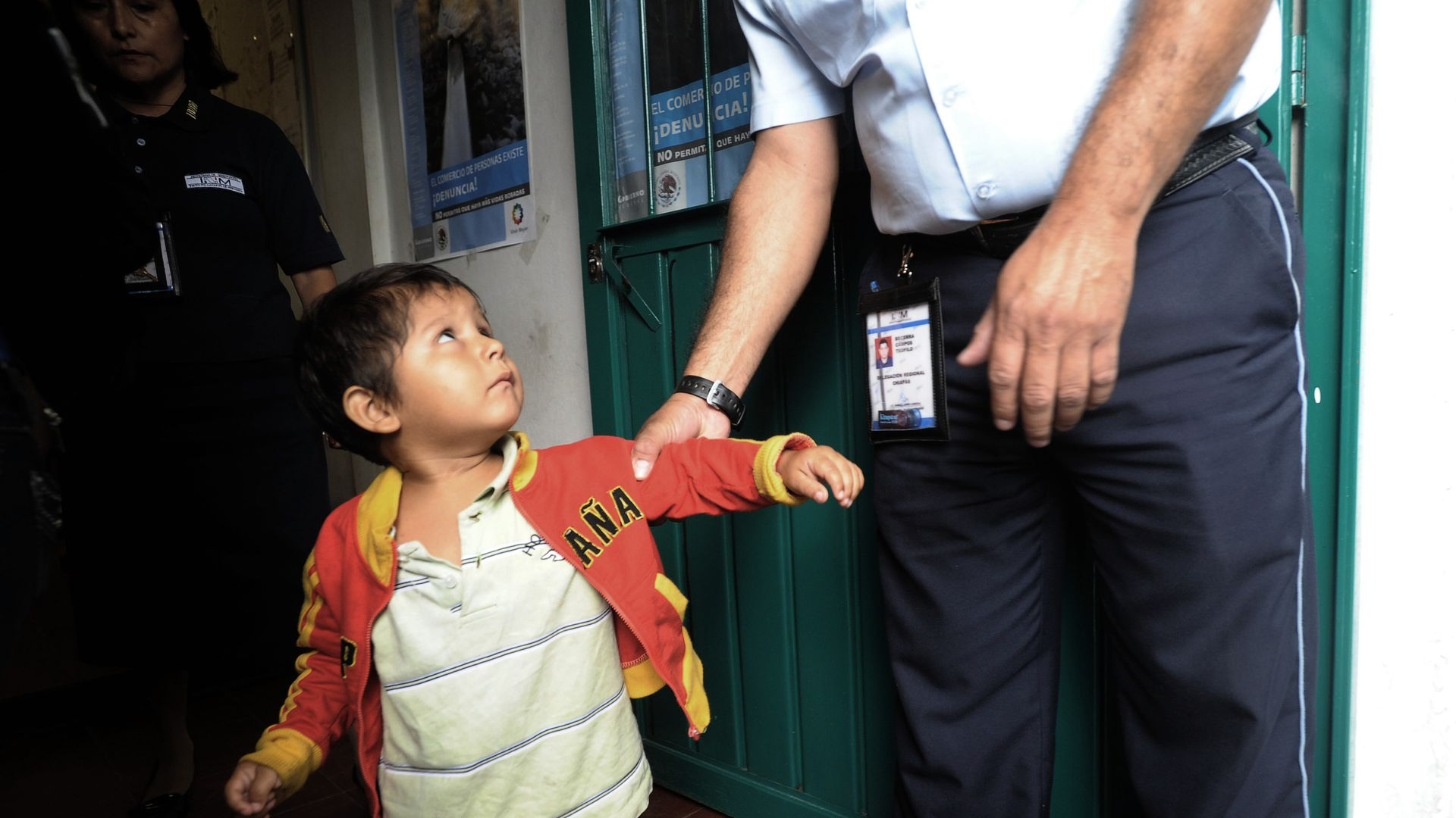 An immigrant child with a police officer.