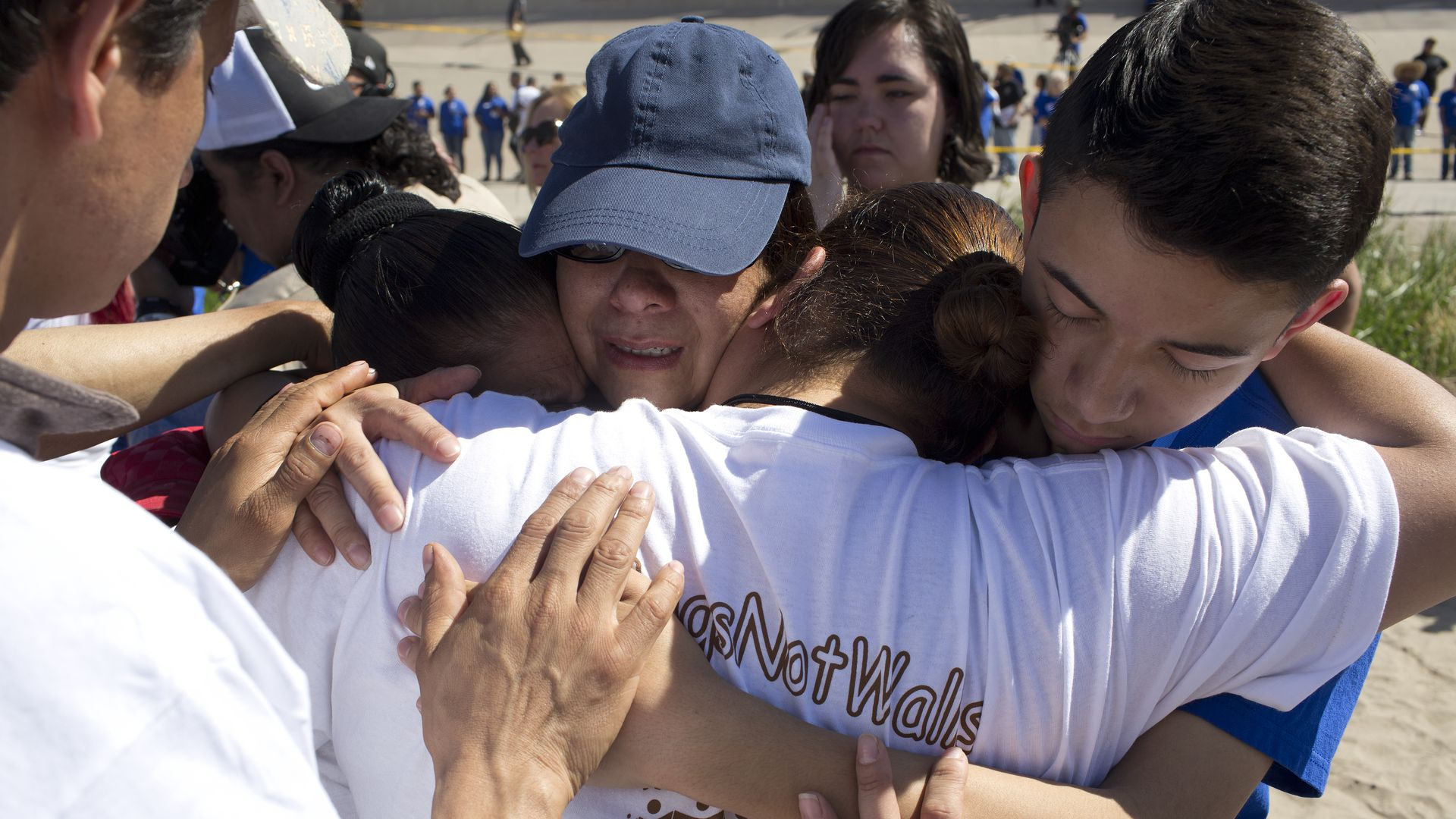 Immigrant families hugging as they're reunited after being separated