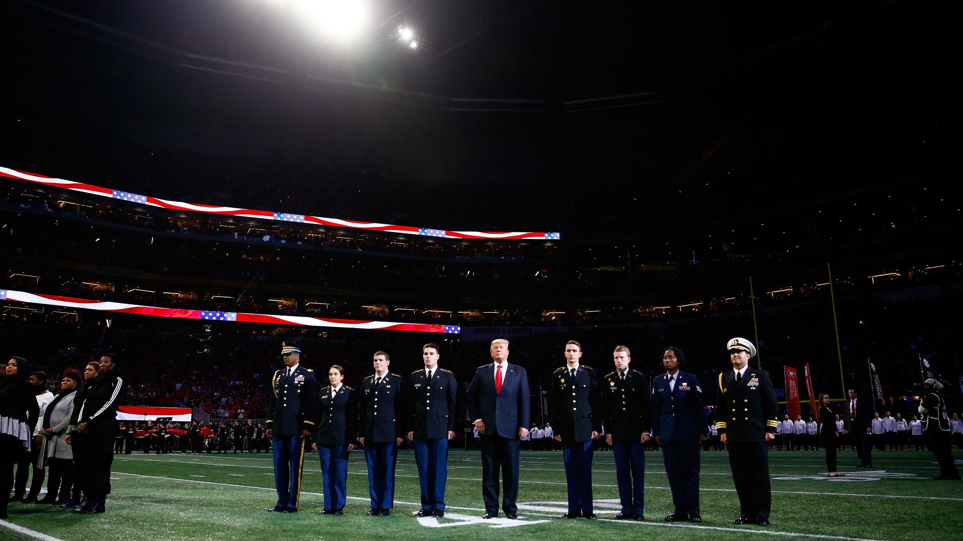 President Donald Trump on field during the national anthem prior to the CFP National Championship.