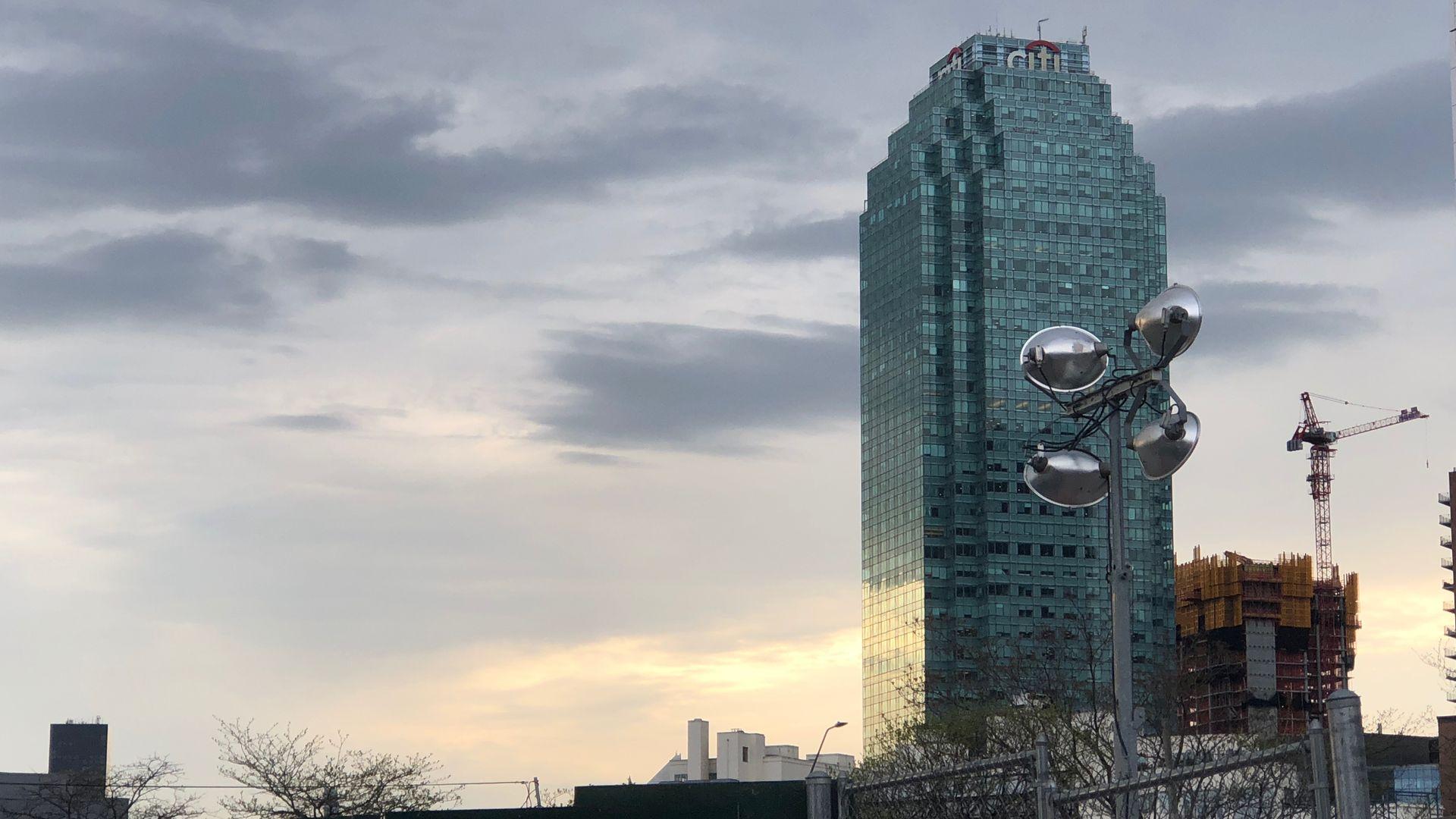 A glass skyscraper against a sunset